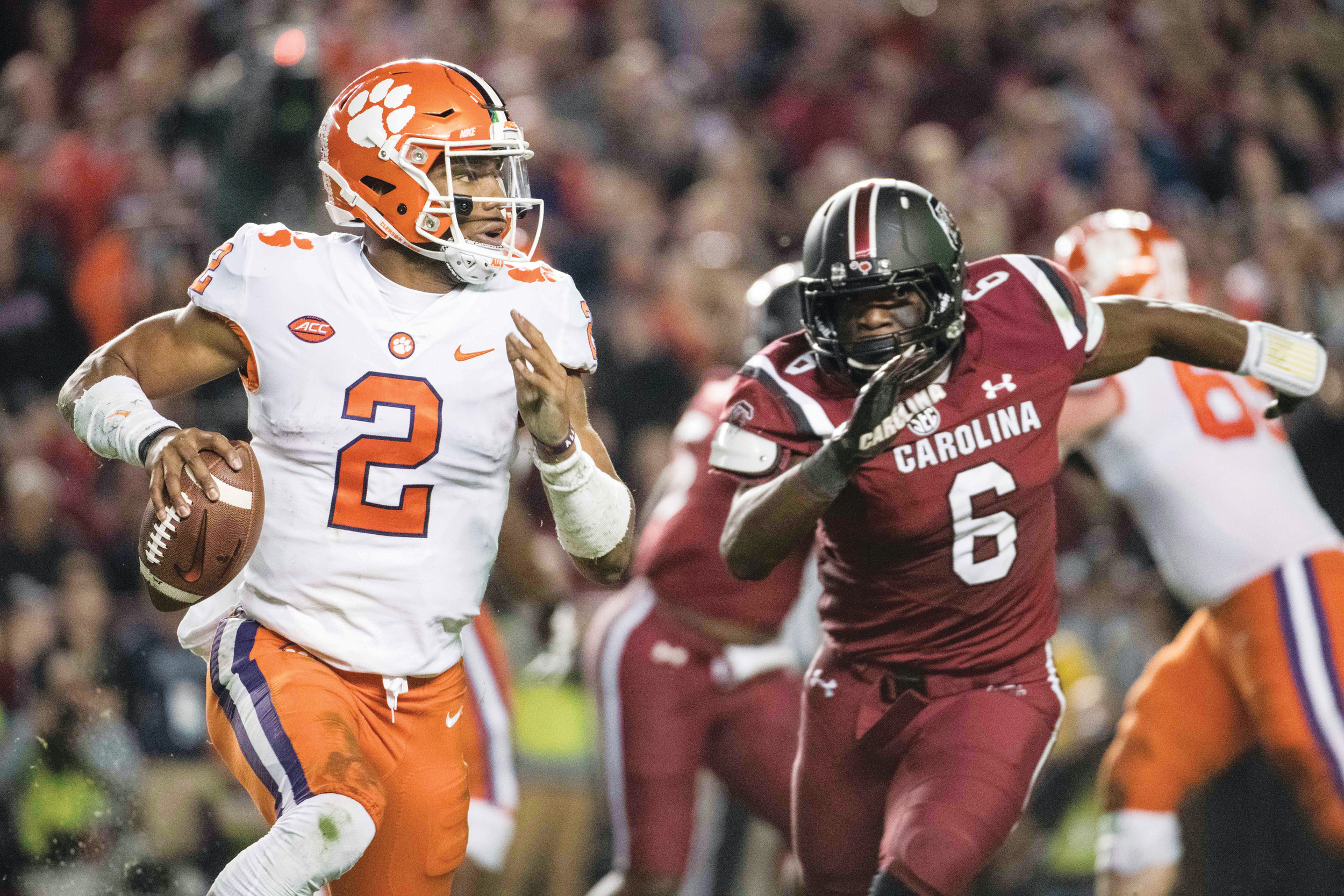 Clemson quarterback Kelly Bryant (2) scrambles from the pocket against South Carolina linebacker T.J. Brunson (6) during the first half of the Tigers' 34-10 victory last Saturday in Columbia. Clemson will face 10-1 Miami in the ACC Championship Game on Saturday.