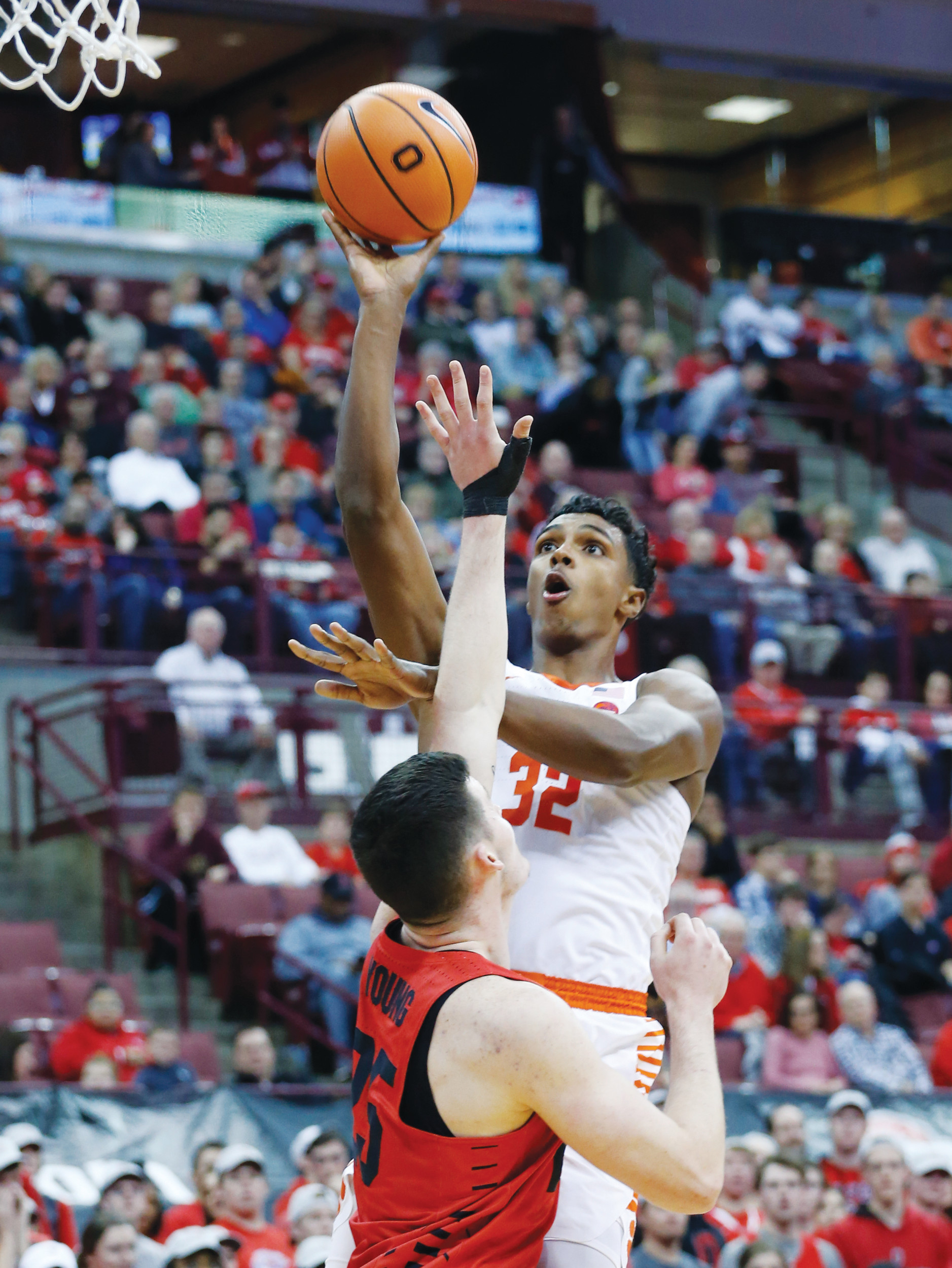 Clemson's Donte Grantham, top, shoots over Ohio State's Kyle Young during the first half of the Tigers' 79-65 victory over the Buckeyes on Wednesday in Columbus, Ohio.