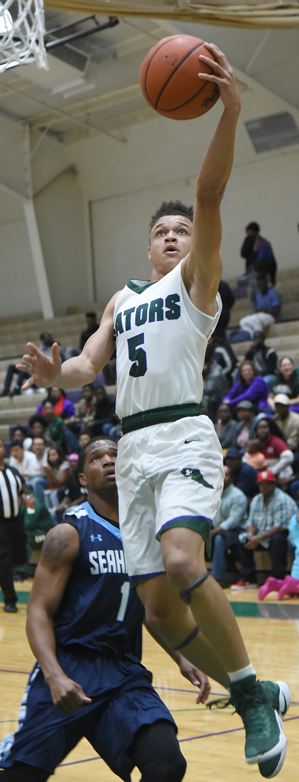 Lakewood's Grant Singleton (5) is rated as one of the top five players in 4A entering this season after averaging 20 points and helping the Gators to their first ever region title.