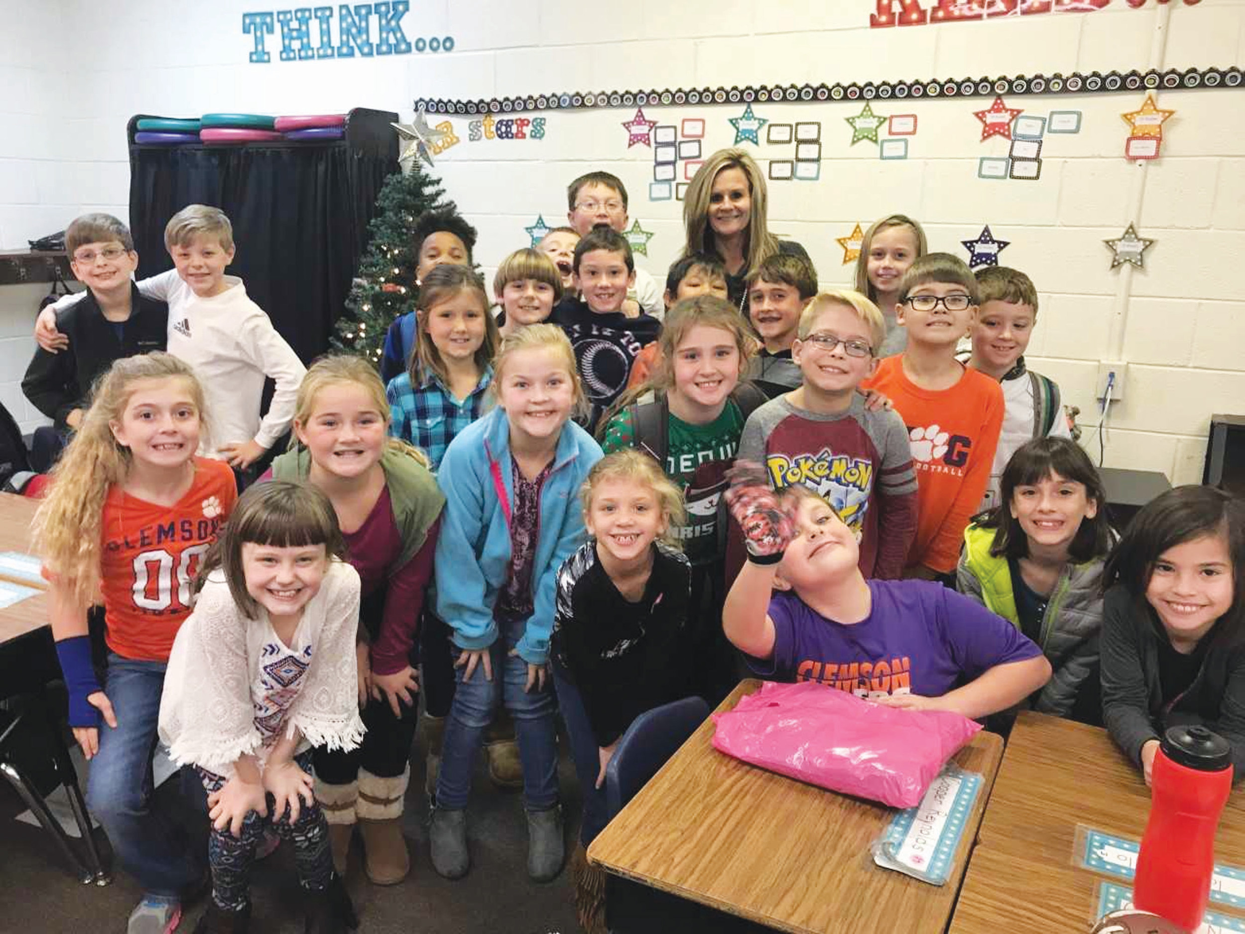 The South Carolina Department of Education has announced the winners of the 2017 Read Your Way to the Big Game Contest, a reading competition that promotes literacy in schools through the Gamecock and Tiger athletic programs. Meg Martin, a third-grade teacher at Laurence Manning Academy, was the recipient of $500 to use in her classroom.