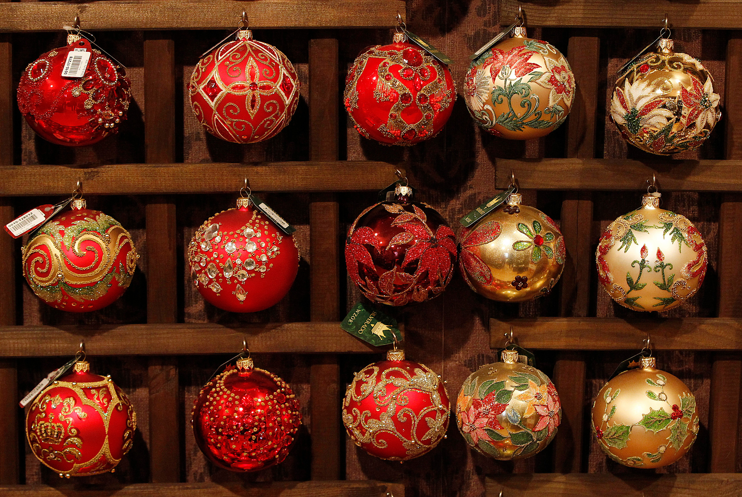 various designs of blown glass christmas tree decorations are on display at the silverado manufacturer - Glass Christmas Decorations
