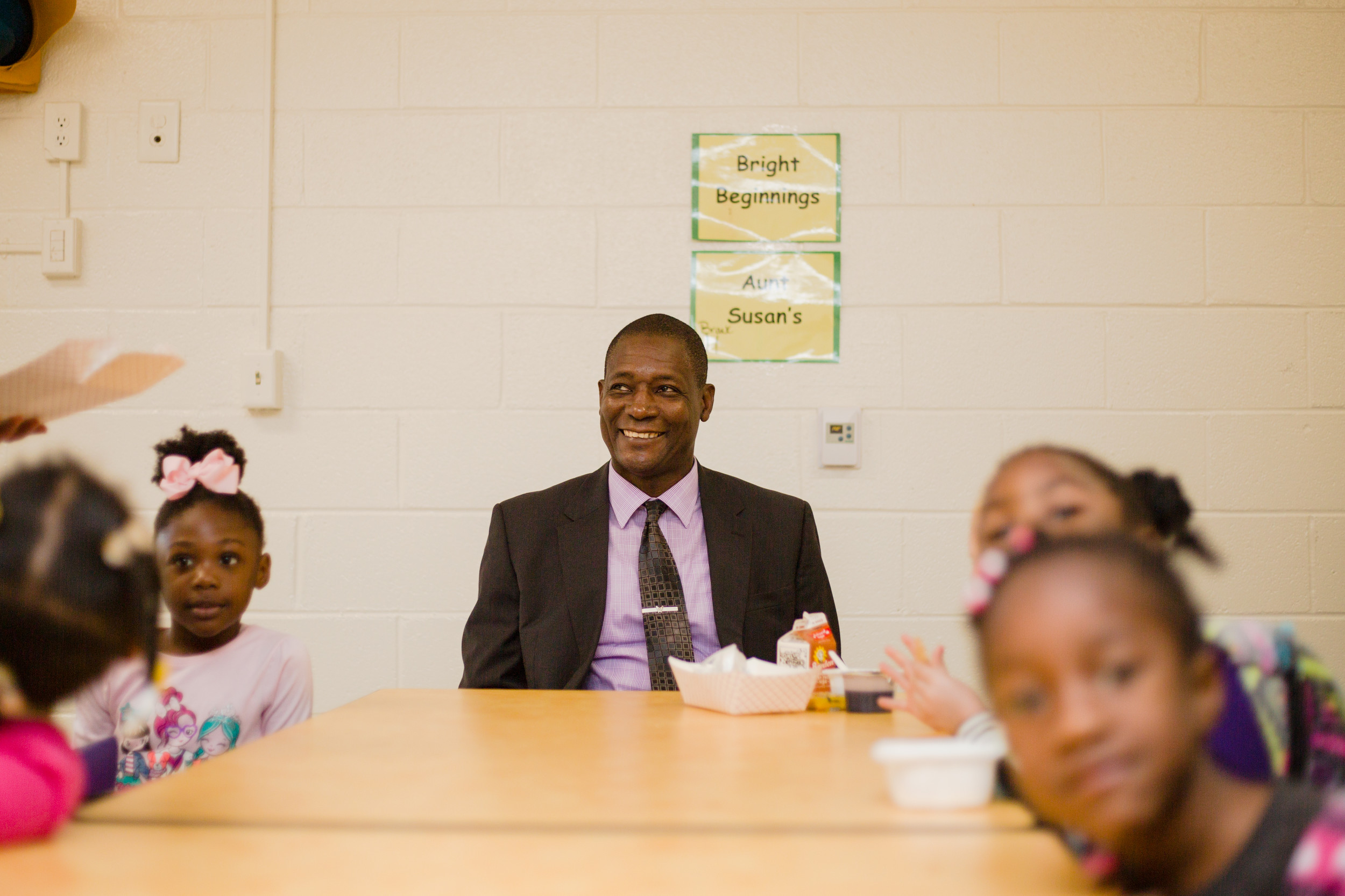 Lefford Fate has breakfast before starting his day as principal for the day at Alice Drive Elementary School on Thursday.