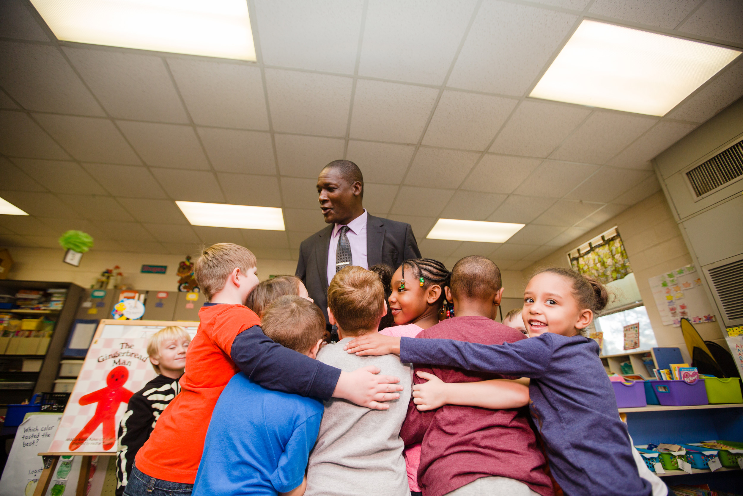 Lefford Fate gets a hug from almost everyone in Stephanie Joye's kindergarten class on Thursday. Fate served as principal for a day at Alice Drive Elementary School.