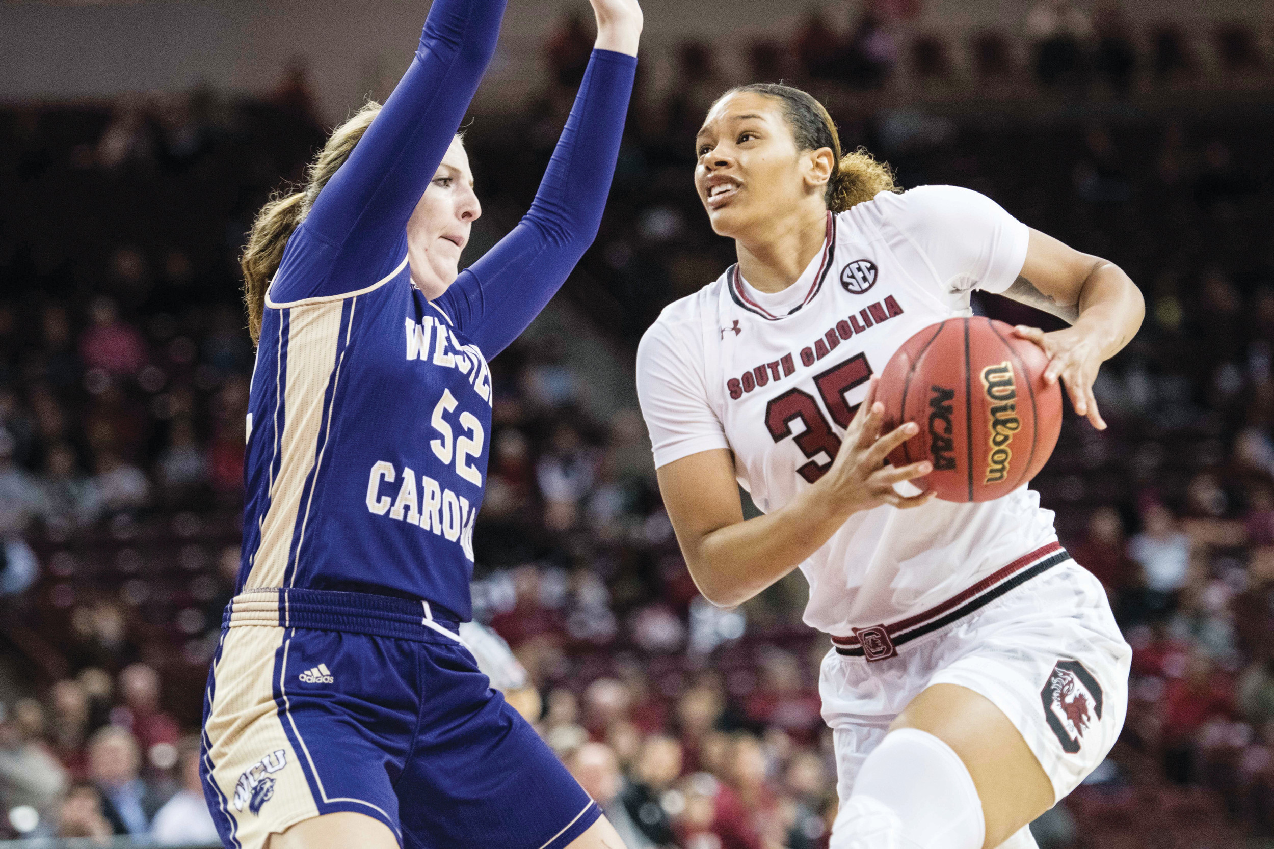 South Carolina forward Alexis Jennings (35) drives to the basket against Western Carolina forward Emily Hatfield (52) during the first half of the Gamecocks' 101-43 victory on Thursday in Columbia.