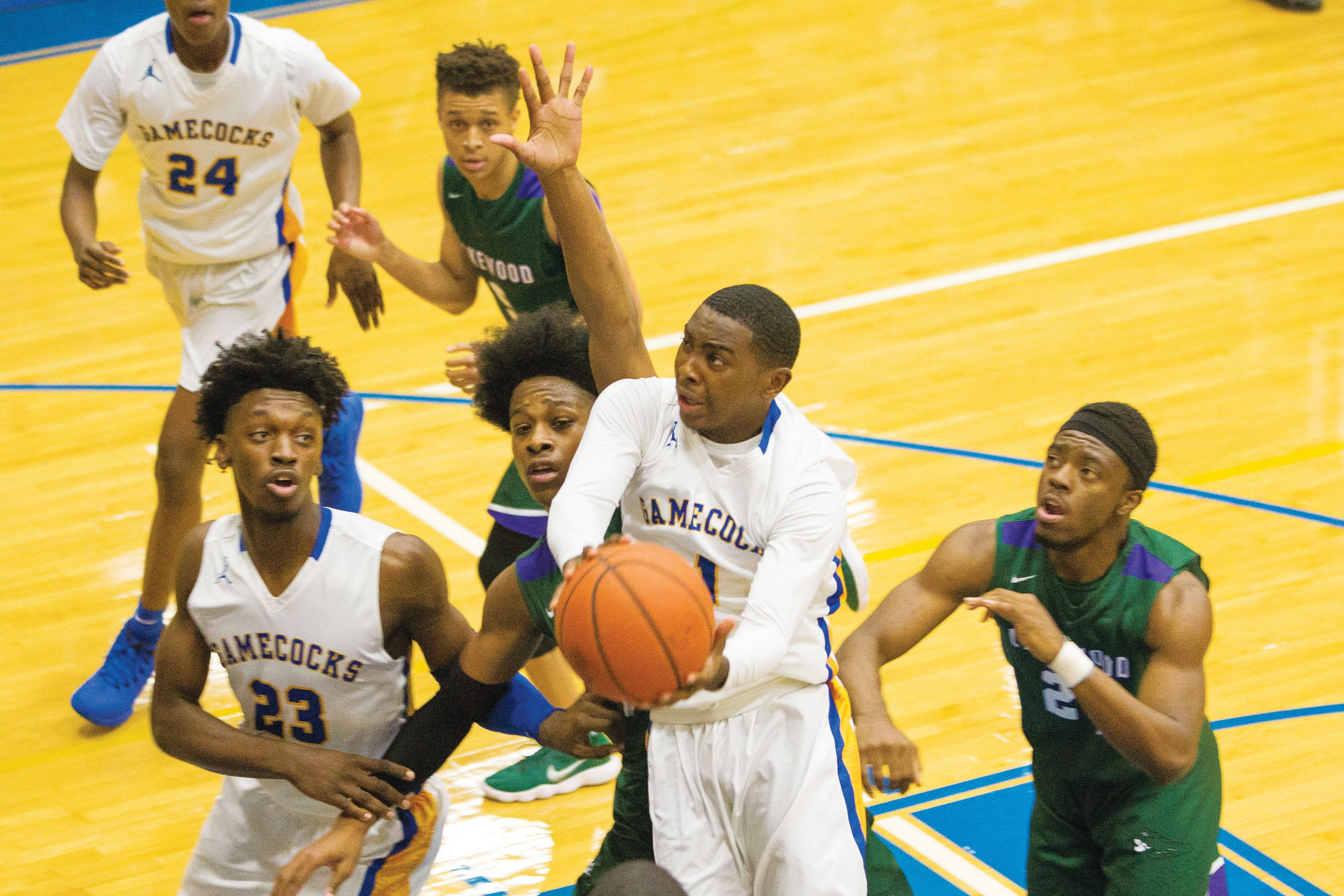 Sumter's Zykiem Jackson (1) drives to the basketball during the Gamecocks' 50-46 overtime victory over Lakewood on Thursday at the SHS gymnasium.