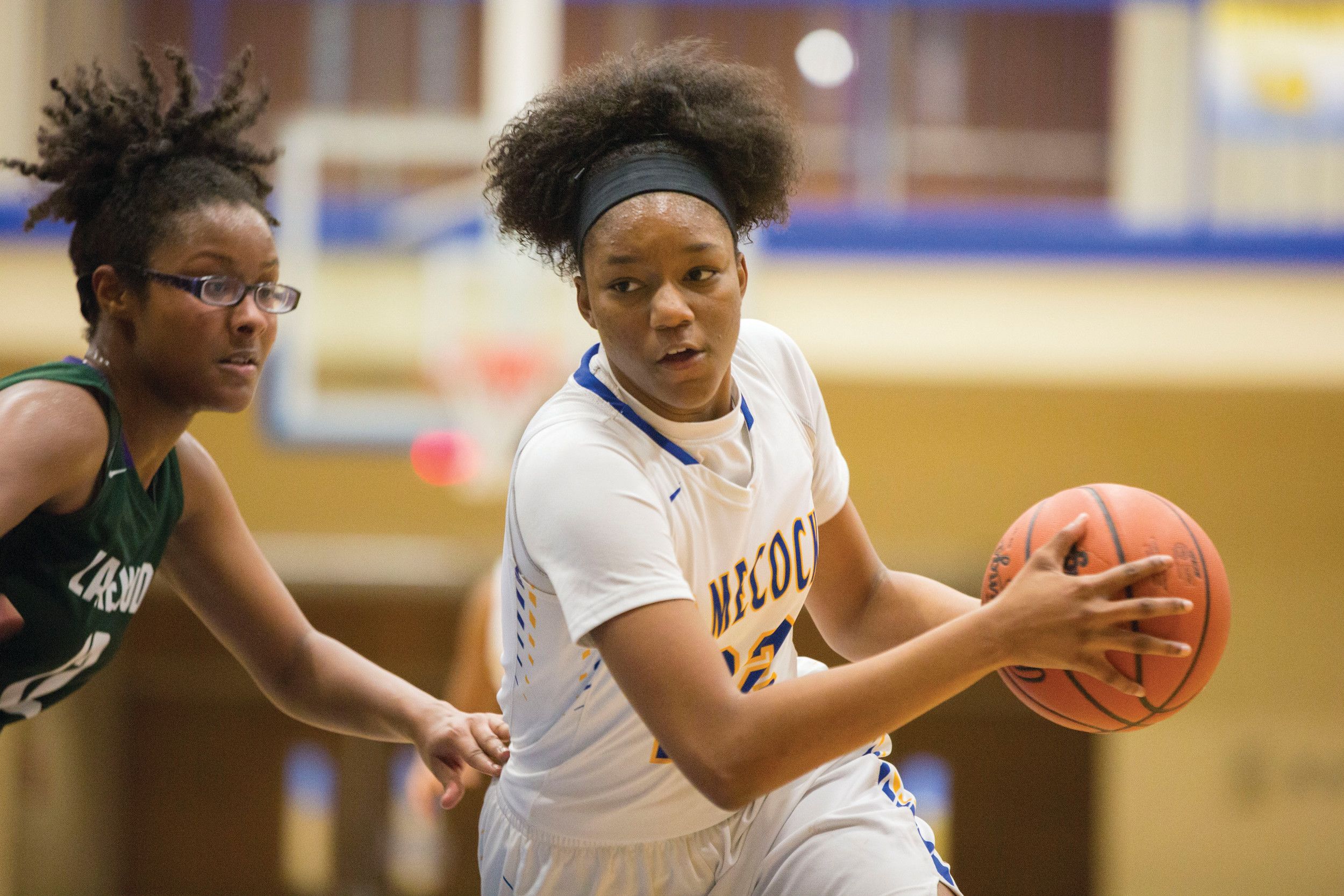 Sumter's Layken Cox, right, drives to the basket against Serena Choice of Lakewood in the Lady Gamecocks' 40-27 victory on Thursday at the SHS gymnasium.