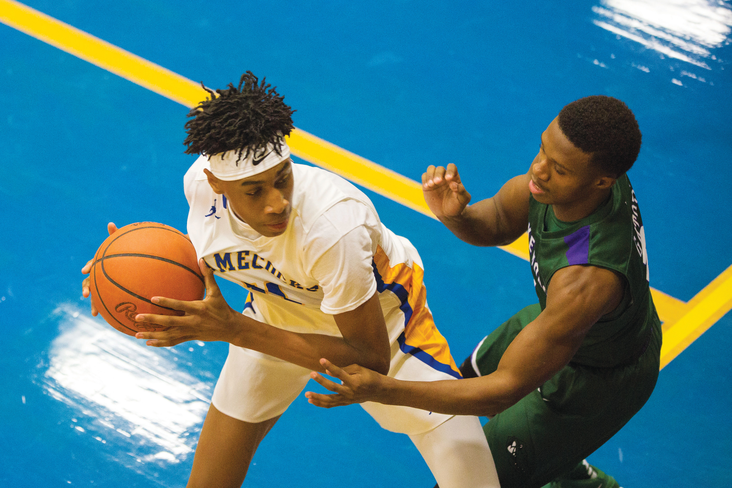 Sumter's Isiah Moore (11) tries to make a move on Lakewood's Ahkeem Lawson in the Gamecocks' 50-46 overtime victory on Thursday at the SHS gymnasium.