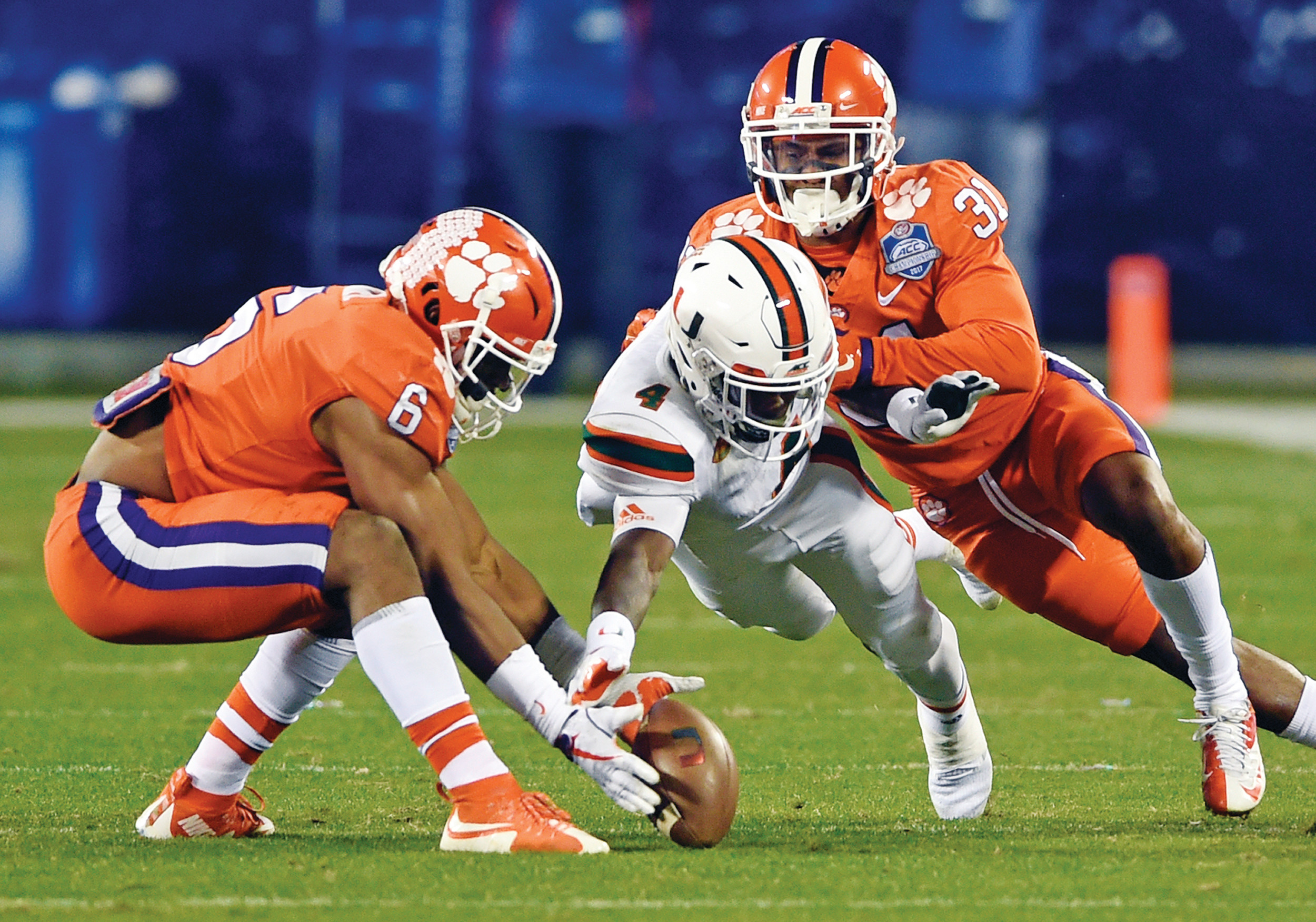 Clemson running back Adam Choice (26) runs against Miami during the second half of the Atlantic Coast Conference championship game on Saturday in Charlotte.