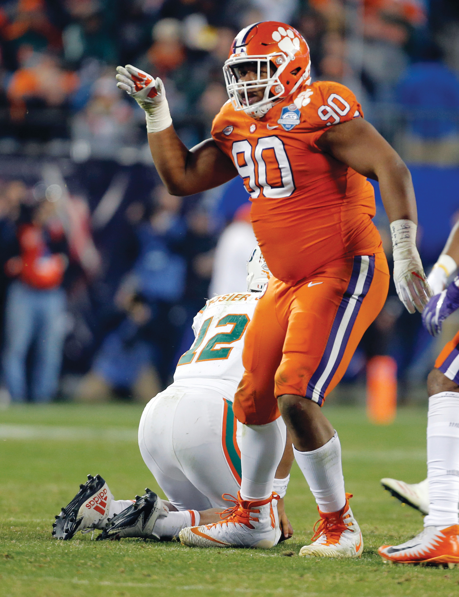 Clemson's Dexter Lawrence (90) celebrates his sack of Miami's Malik Rosier (12) during the second half of the Atlantic Coast Conference championship game in Charlotte on Saturday.