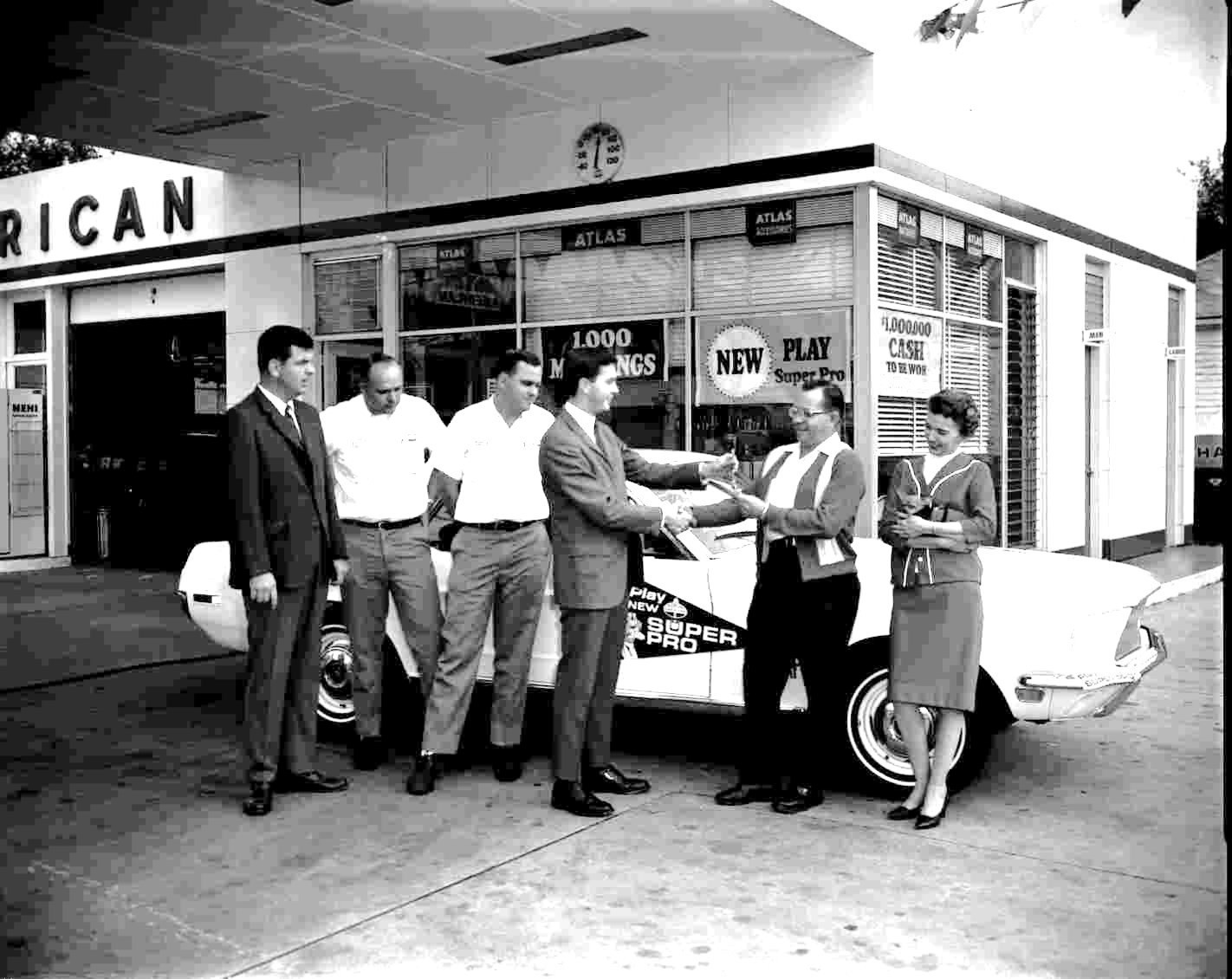 Rumph, left, is shown at his American gas station on Liberty Street in 1967.