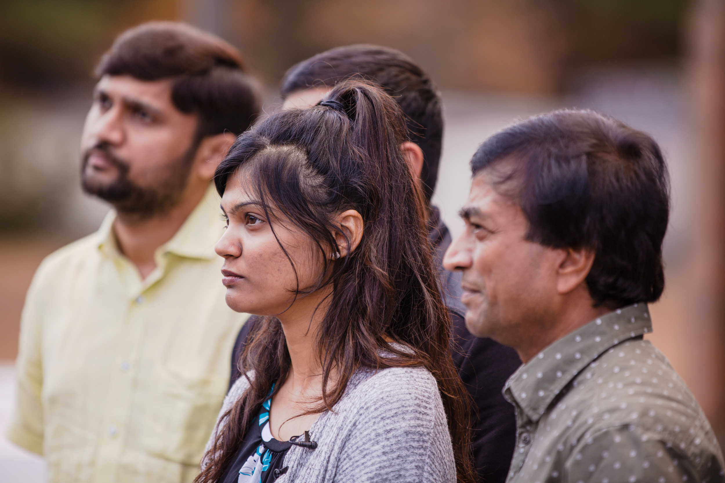 Patel's family listens to a question from reporters following the hearing.