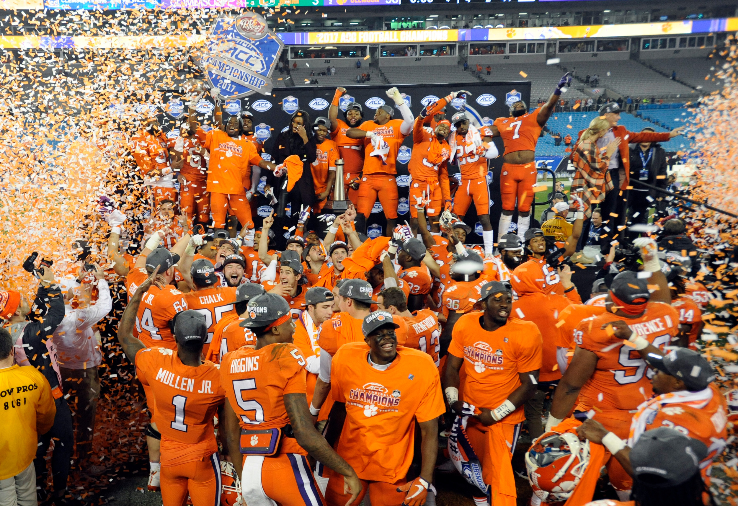 Clemson players celebrate after winning the Atlantic Coast Conference championship game over Miami 38-3 on Saturday in Charlotte. The Tigers will meet Alabama for the third straight year in the College Football Playoff, this time in the Sugar Bowl in a semifinal game on Jan. 1