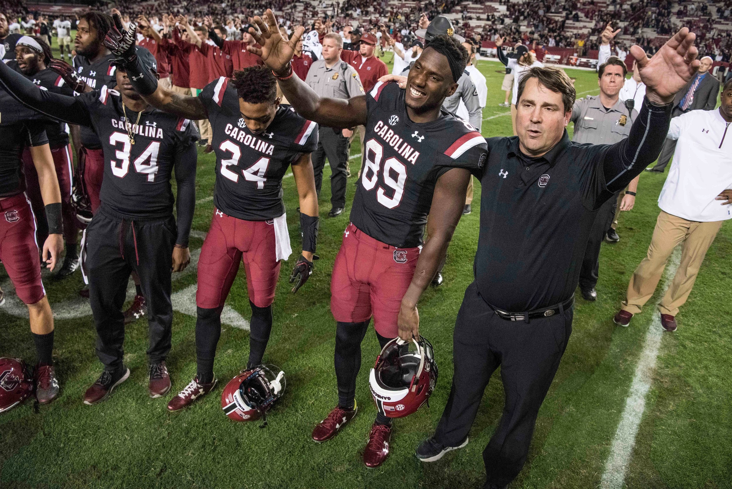 South Carolina head coach Will Muschamp, right, and wide receiver Bryan Edwards (89) participate in the alma mater after the conclusion an NCAA college football game on Saturday, Nov. 18, 2017 in Columbia, S.C. South Carolina defeated Wofford 31-10. (AP Photo/Sean Rayford)