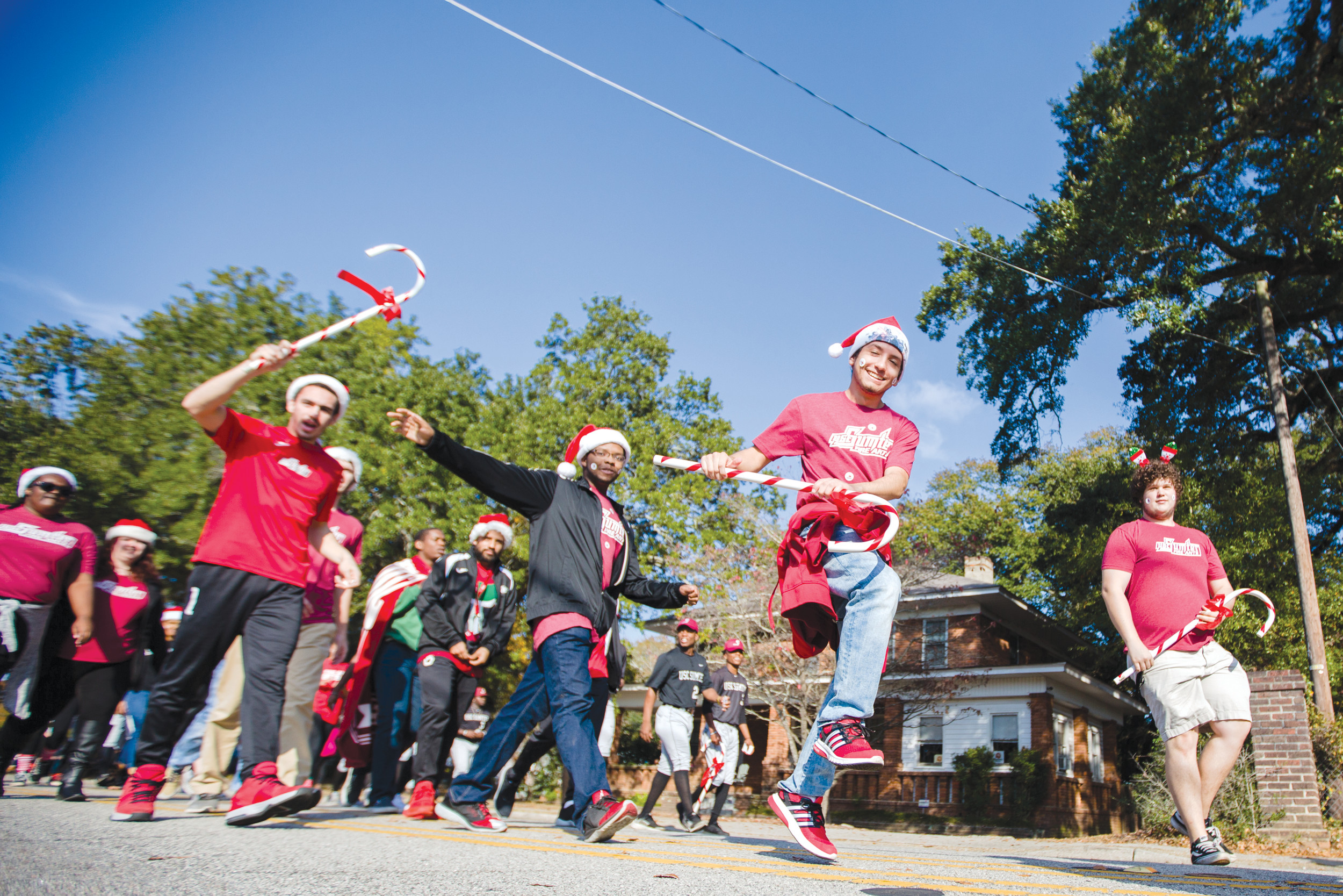 Students from University of South Carolina Sumter march at the annual Sumter Christmas Parade as they make their way along the route on Sunday.