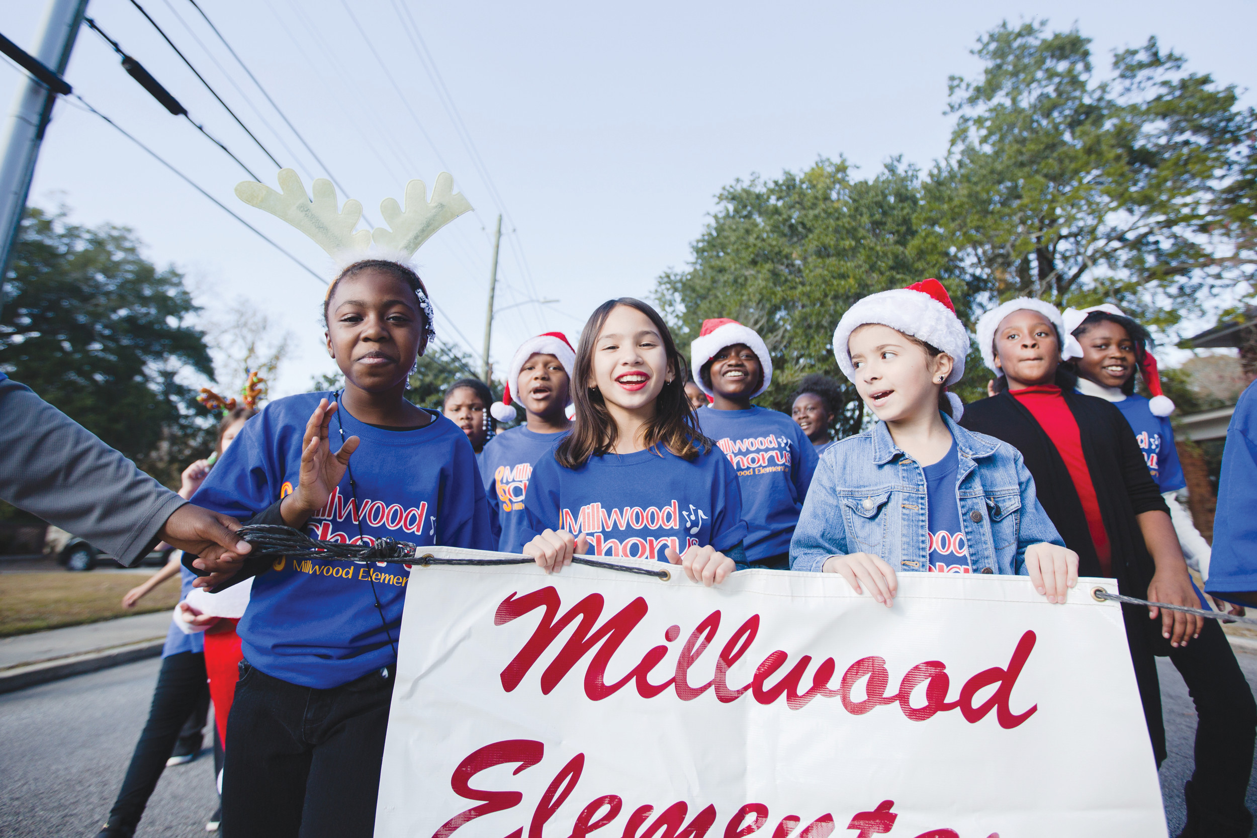 Millwood Elementary School students march Sunday in the annual Sumter Christmas Parade.