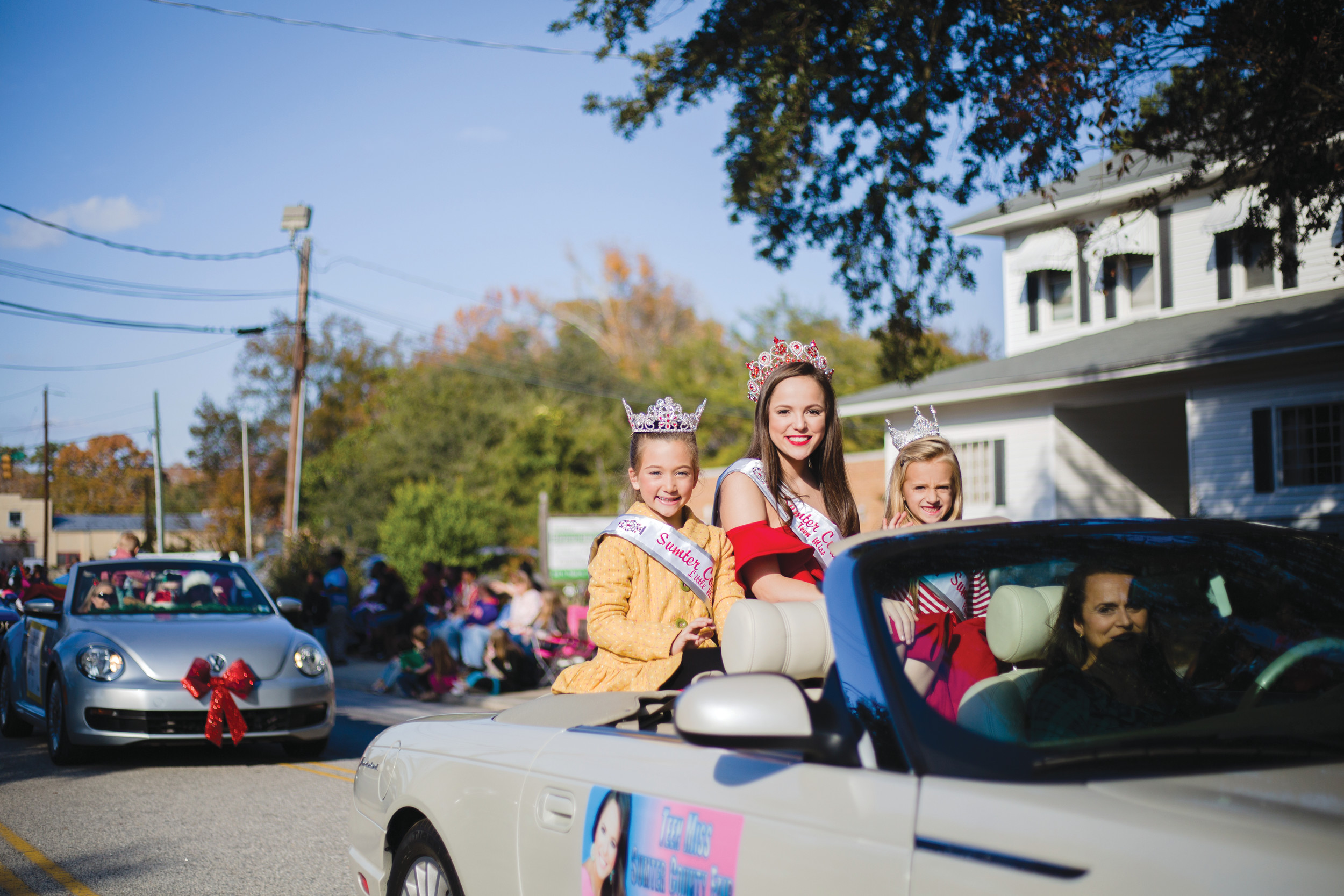 Teen Miss Sumter County Fair Gabby Hill rides with two girls at the annual parade.