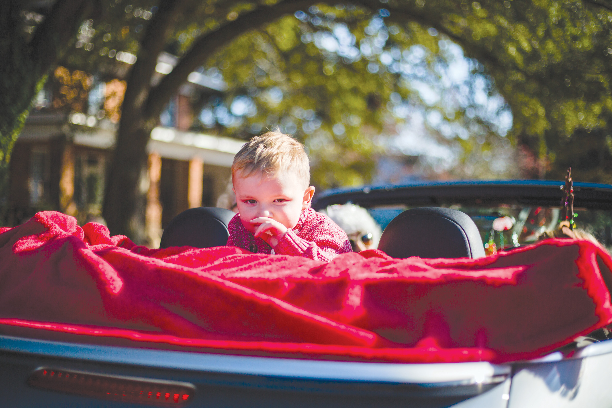 Sumter County Fair Master David Melton rides on the back of his car at the annual Sumter Christmas Parade on Sunday.