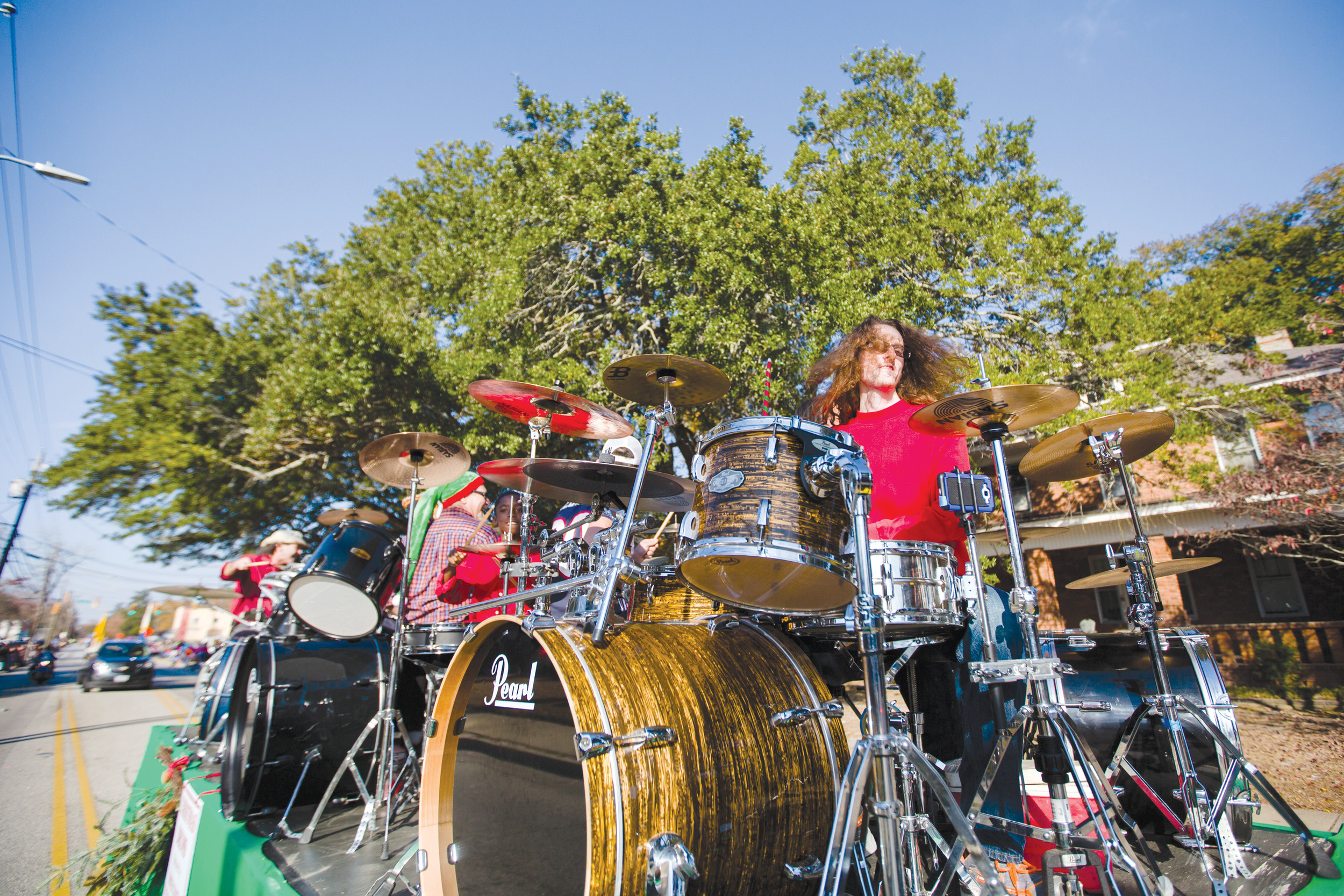 Drummers play on a float at the annual Sumter Christmas Parade on Sunday.