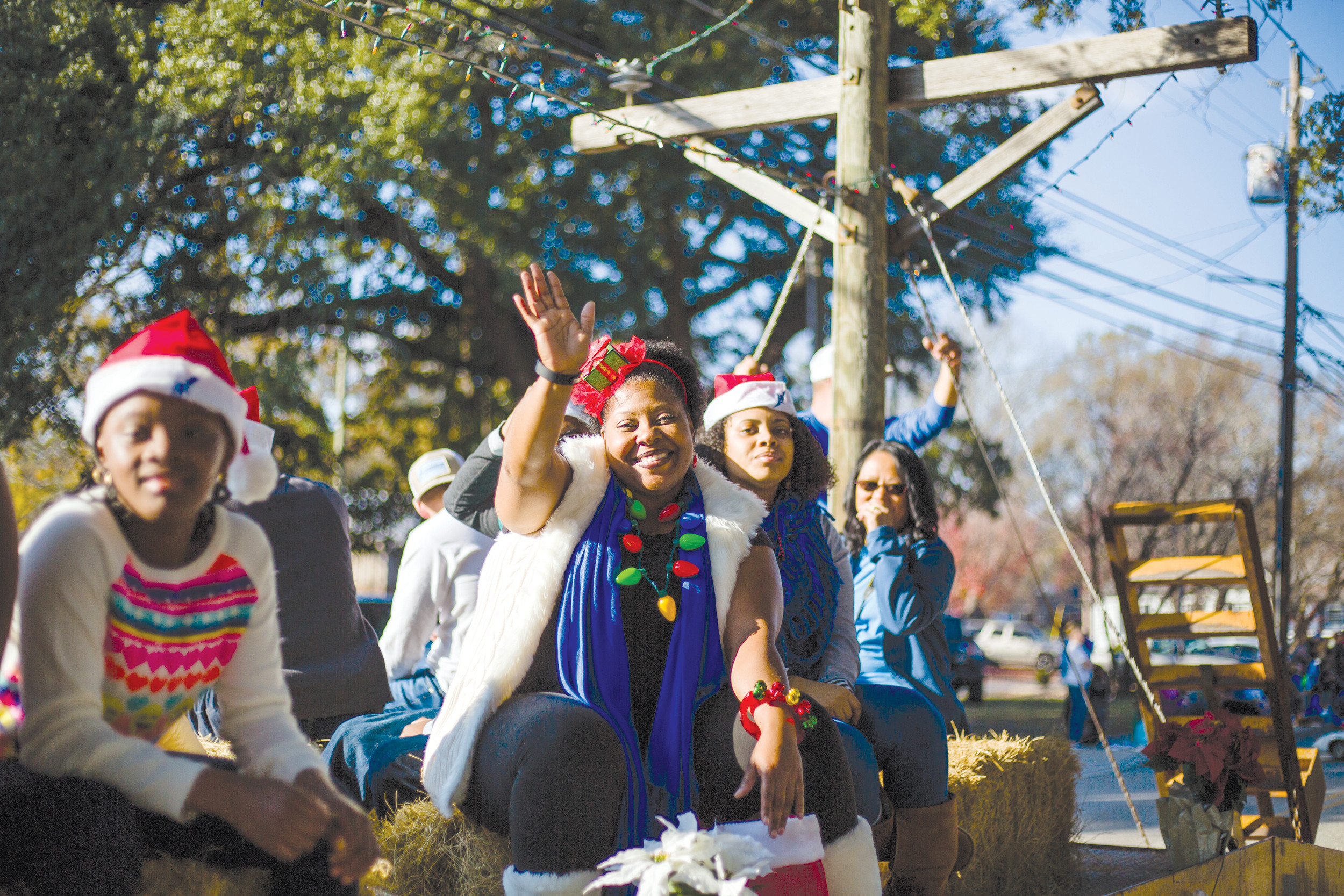 A woman waves from a float at the annual Sumter Christmas Parade on Sunday.