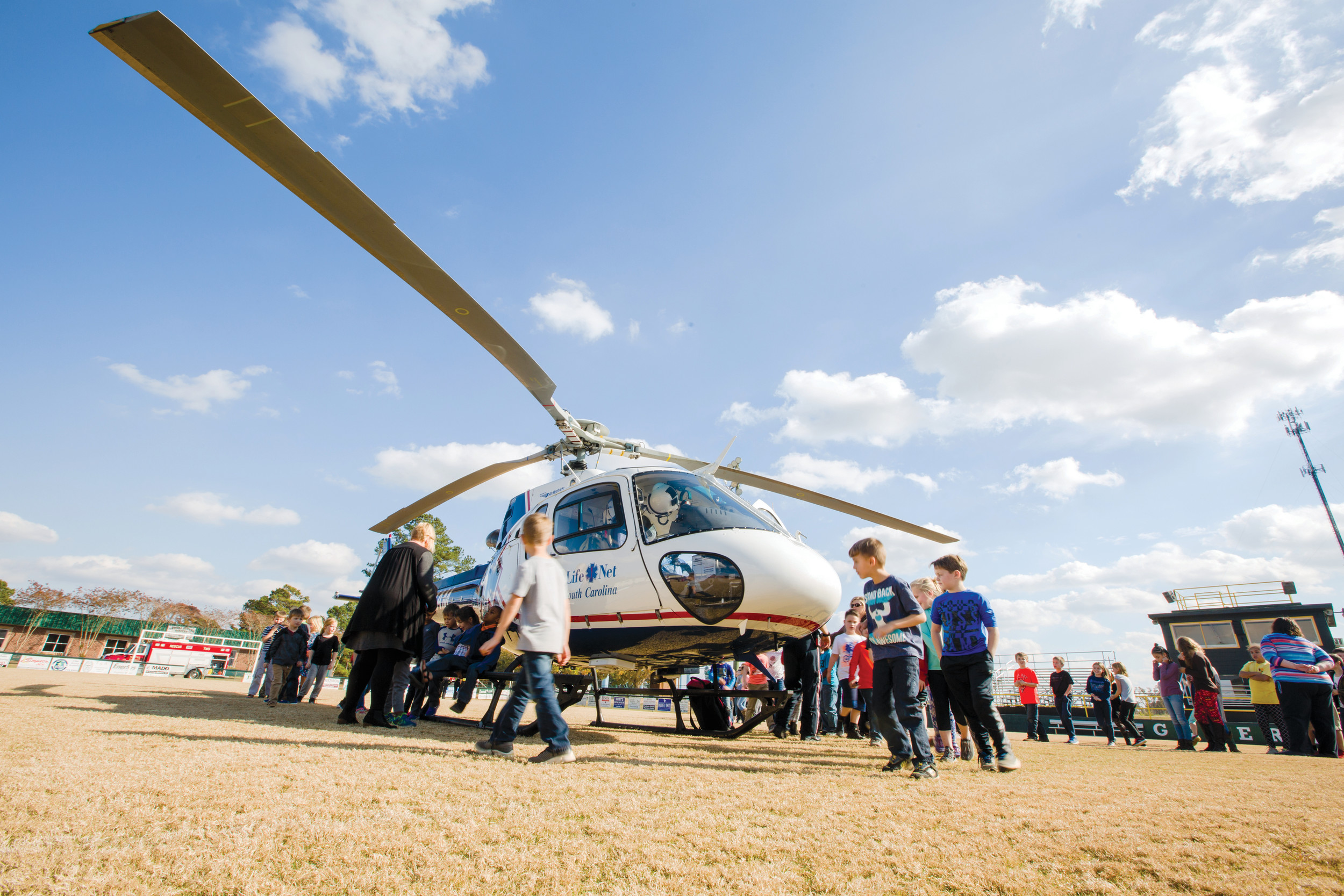 Elementary students from Thomas Sumter Academy check out the Life Net helicopter after it landed on the school's football field during a demonstration.