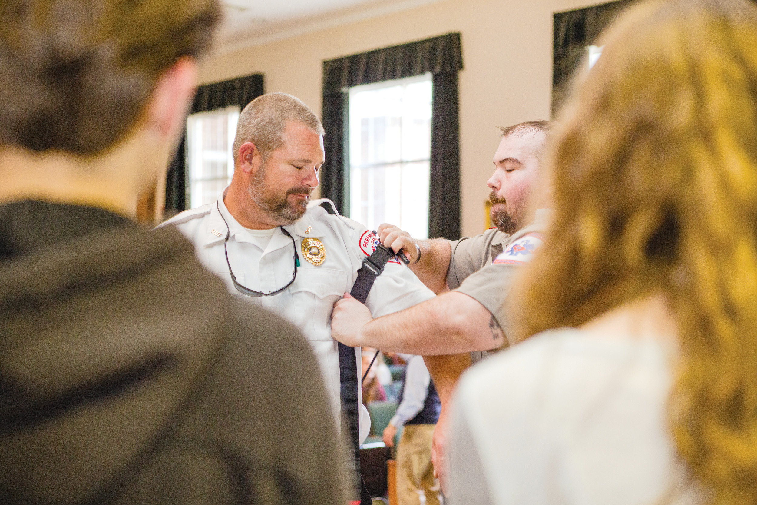 EMT Tracy Caulder teaches students at Thomas Sumter Academy how to properly use a tourniquet on EMS Chief Bobby Hingst on Wednesday.