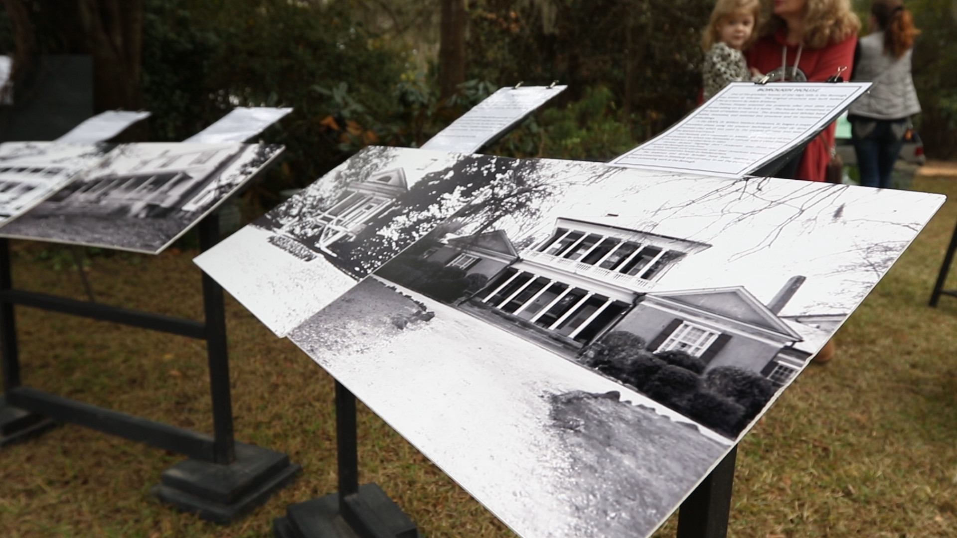 Vintage photos of the property are seen during the event.