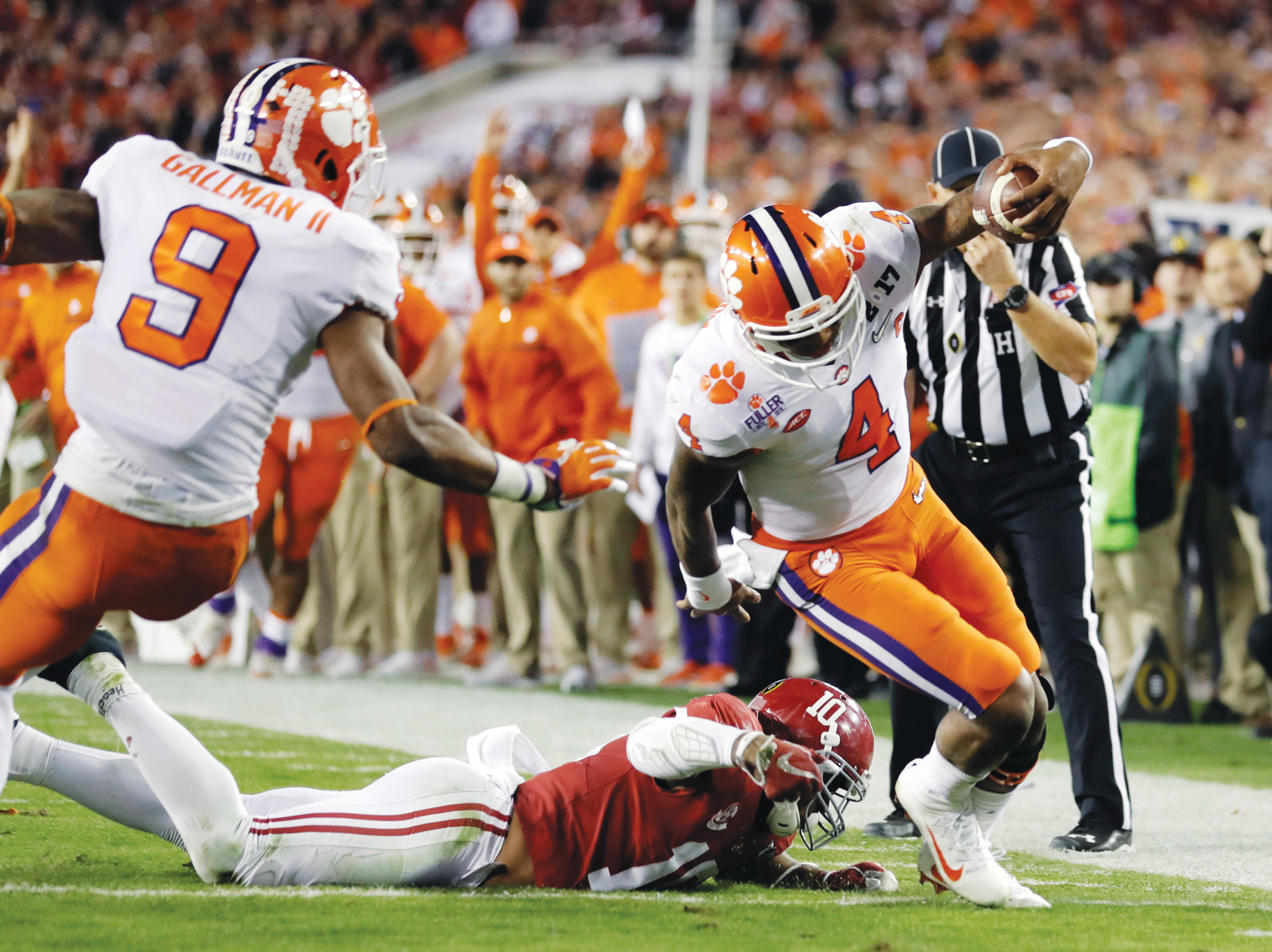 Clemson quarterback Deshaun Watson runs for a touchdown during the Tigers' 45-42 victory over Alabama in the 2017 College Football Playoff championship game. With the Pac-12 and Big Ten not represented in the 4-team playoff, a TV sports viewership analyst said interest could be tempered on the West Coast, upper Midwest and Northeast for this year's playoff.