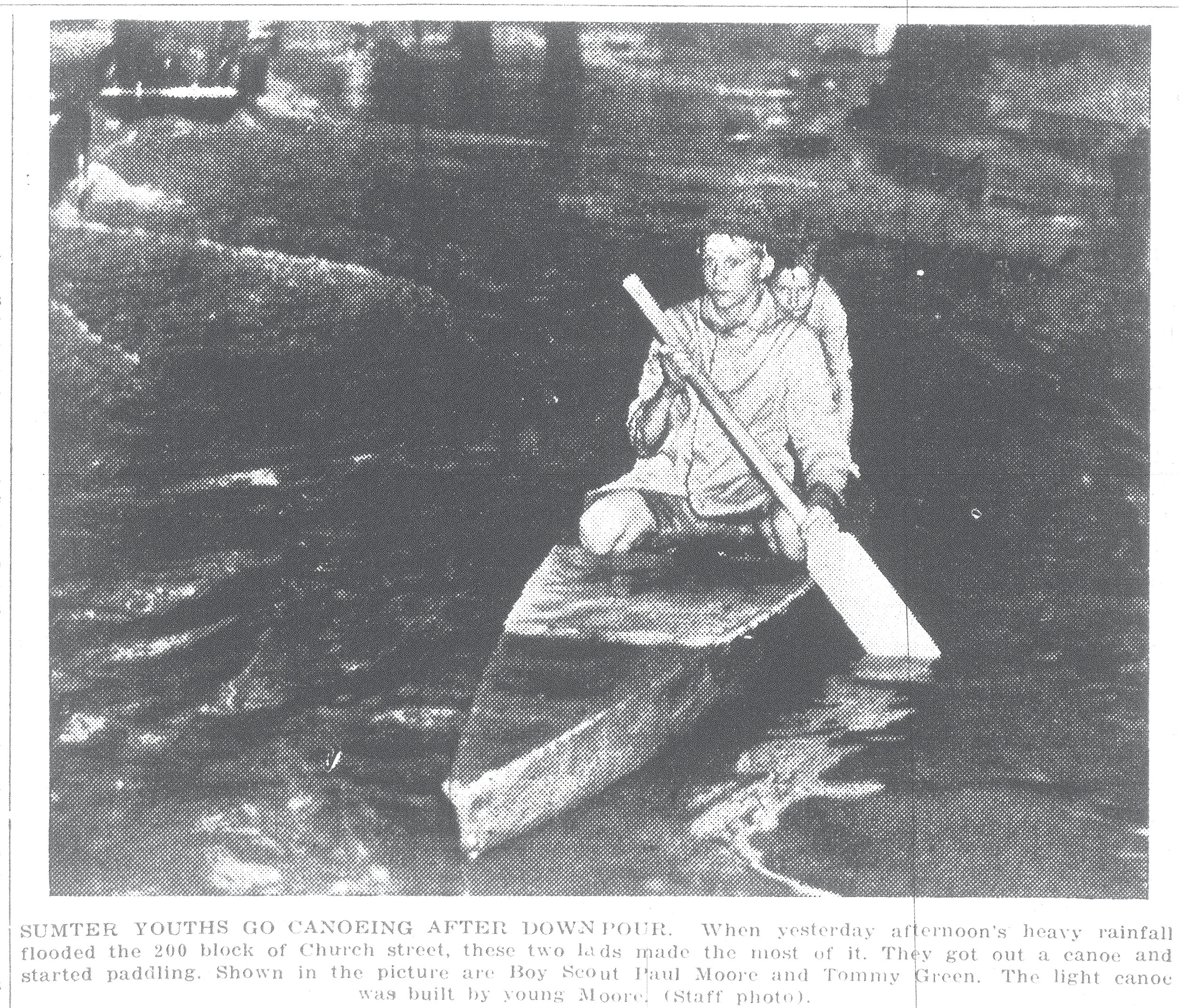 When a heavy afternoon rainfall flooded the 200 block of Church Street in 1943, two children, Boy Scout Paul Moore and Tommy Green, made the most of it. They got a canoe made by Moore and started paddling.