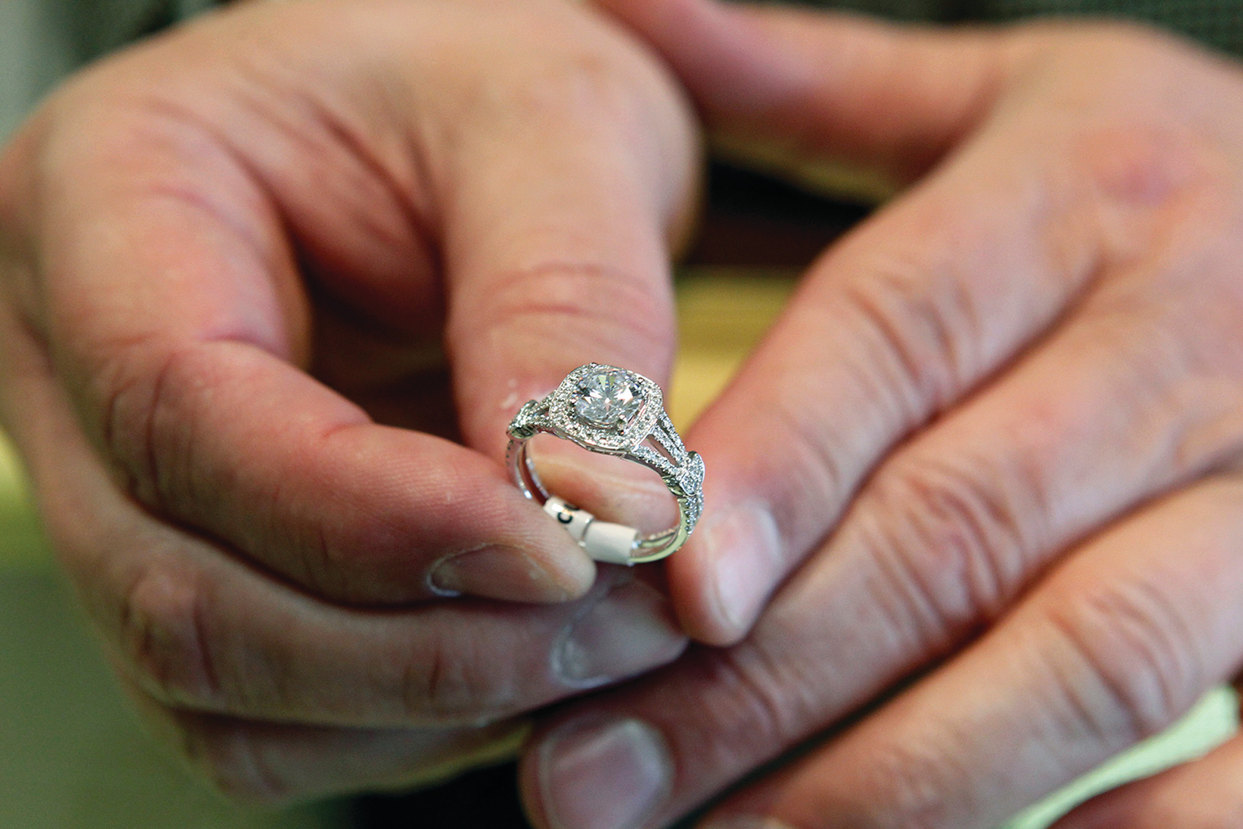 FILE - In this May 14, 2014, file photo, Brad Padgett, owner of Bradley's Jewelers, shows off one of his favorite engagement rings in Jacksonville, N.C. It's not exactly romantic, but engagement ring insurance is a relatively inexpensive way to make sure you can repair or replace your ring in case of theft, damage or mysterious disappearance. (Maria Sestito/The Jacksonville Daily News via AP, File)