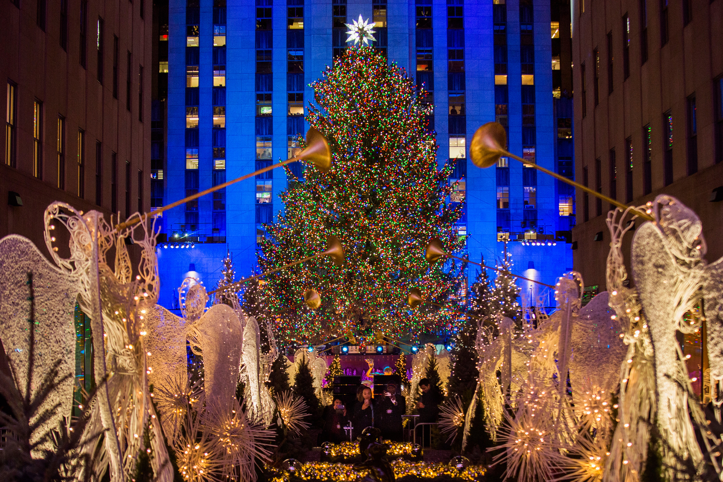 The Rockefeller Center Christmas tree stands lit as people take photos of it and the holiday & After lights dim Rockefeller Christmas trees still give | The ...