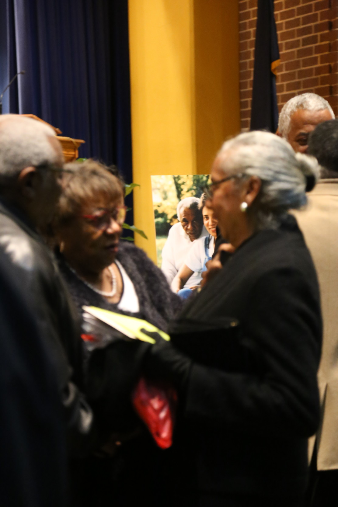 Frances Finney, wife of retired chief justice Ernest A. Finney Jr., speaks with guests during a public visitation service for her husband.