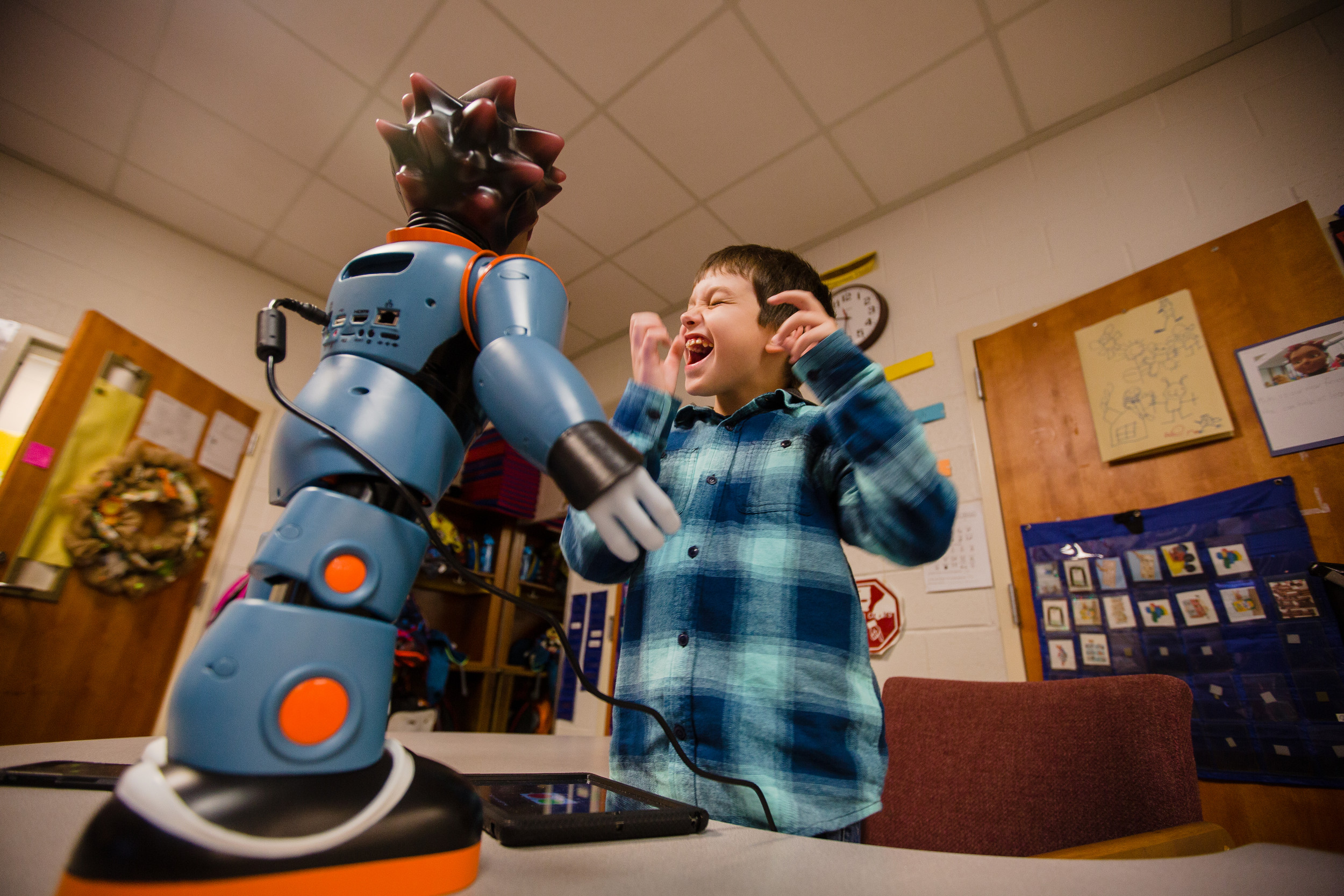 Devin Chaplin, 7, dances with Milo during exercises in Julie Jeffcoat's classroom at Kingsbury Elementary.