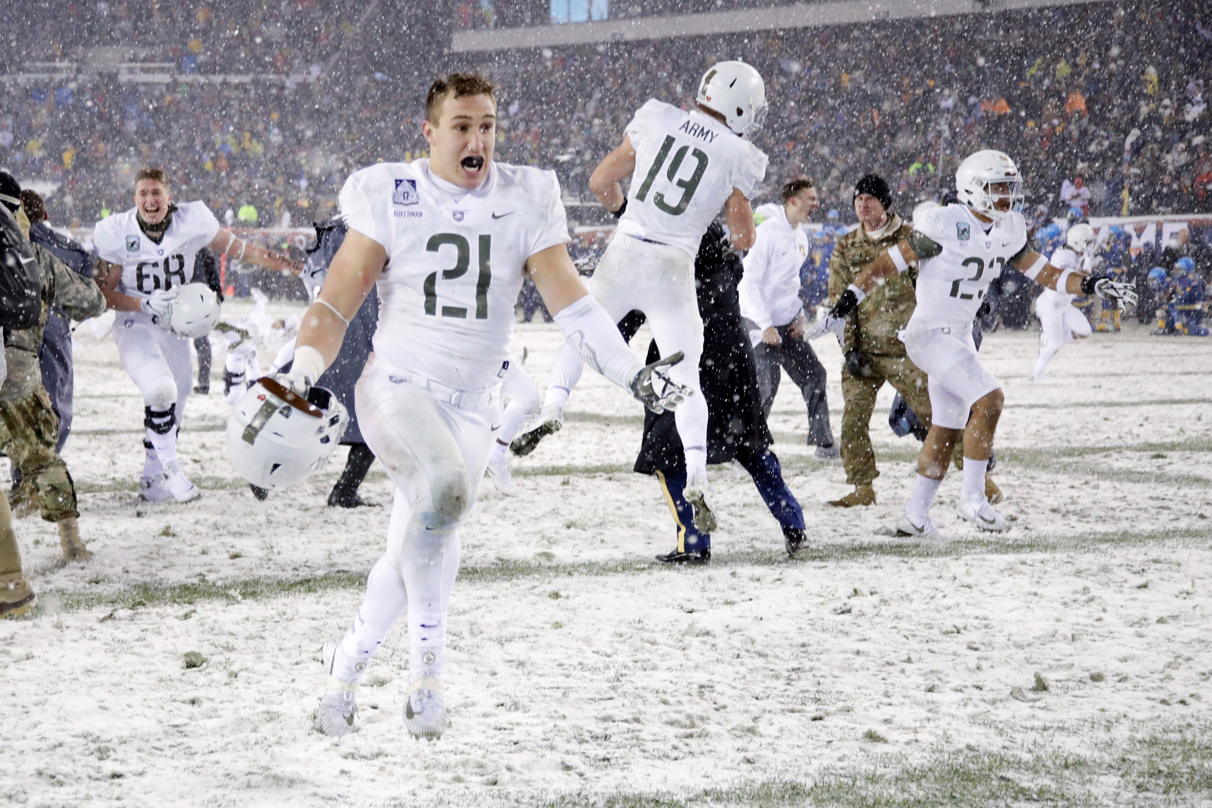 THE ASSOCIATED PRESSArmy's Alex Aukerman (21) celebrates with his teammates after a missed field goal on the game's final play gave Army a 14-13 victory over Navy in snowy Philadelphia on Saturday. Sumter resident Tom O'Hare took in his first game of the rivalry, braving the frigid weather to put a check on his bucket list.