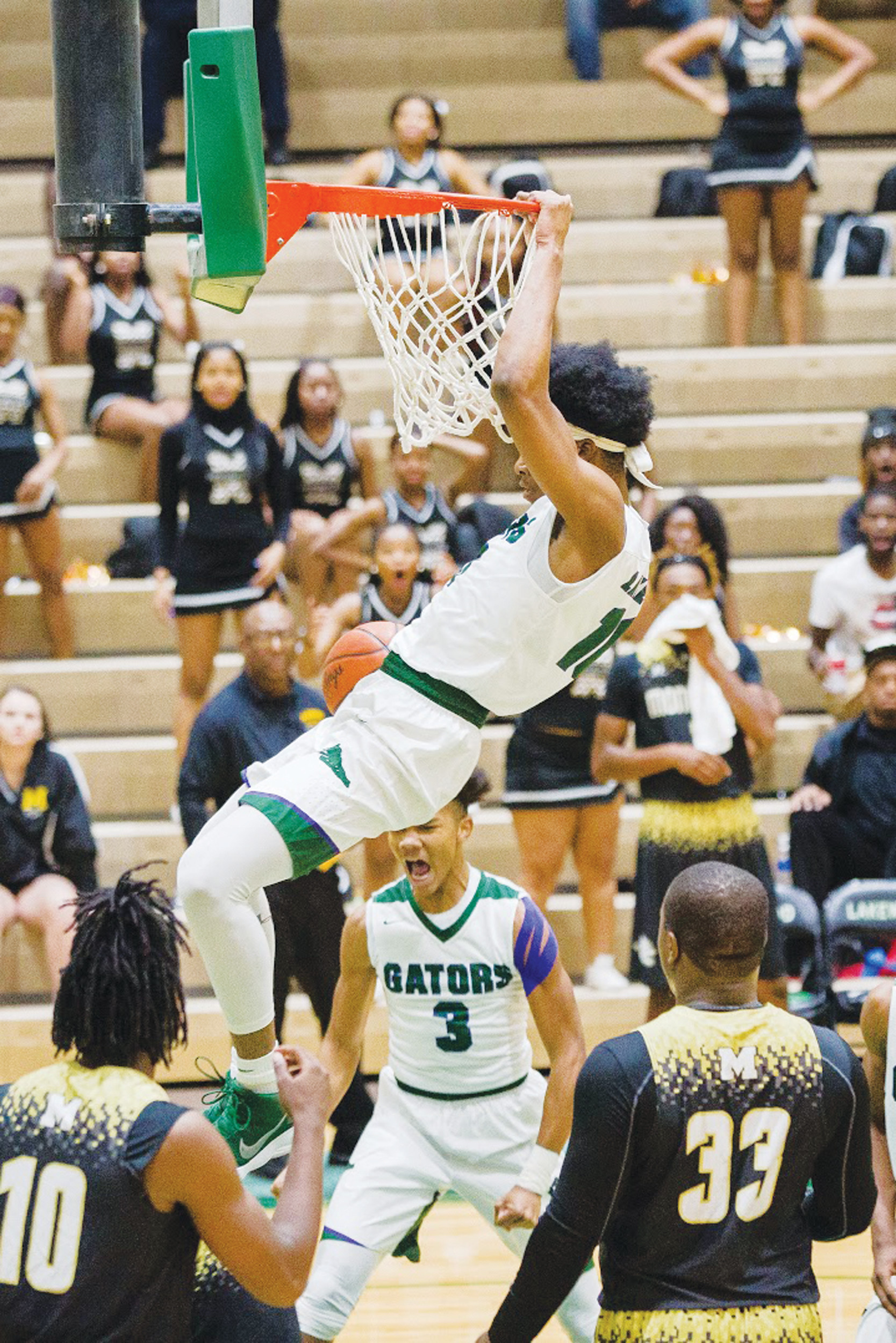 Lakewood's Juwan Perdue throws down a dunk during the Gators' 56-37 victory over Manning on Tuesday at The Swamp.