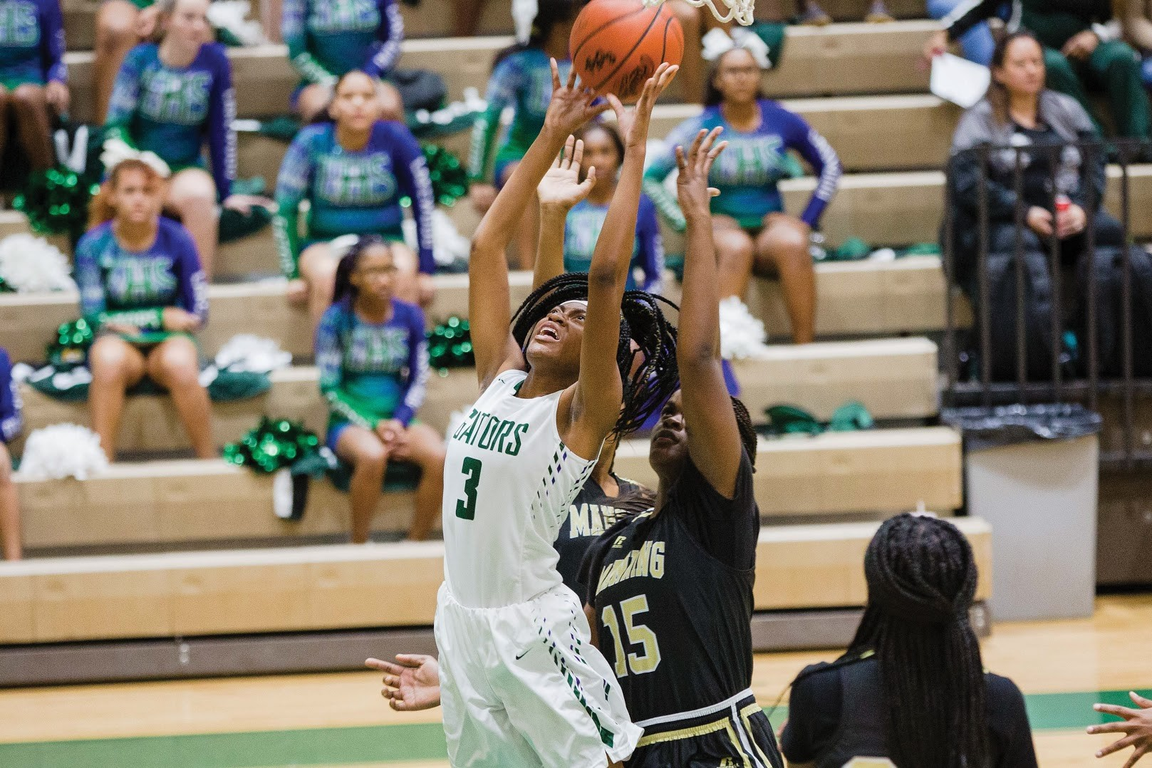 Lakewood's Zaria Stephens goes up for a rebound during the Gators' 39-38 loss to Manning on Tuesday at The Swamp.