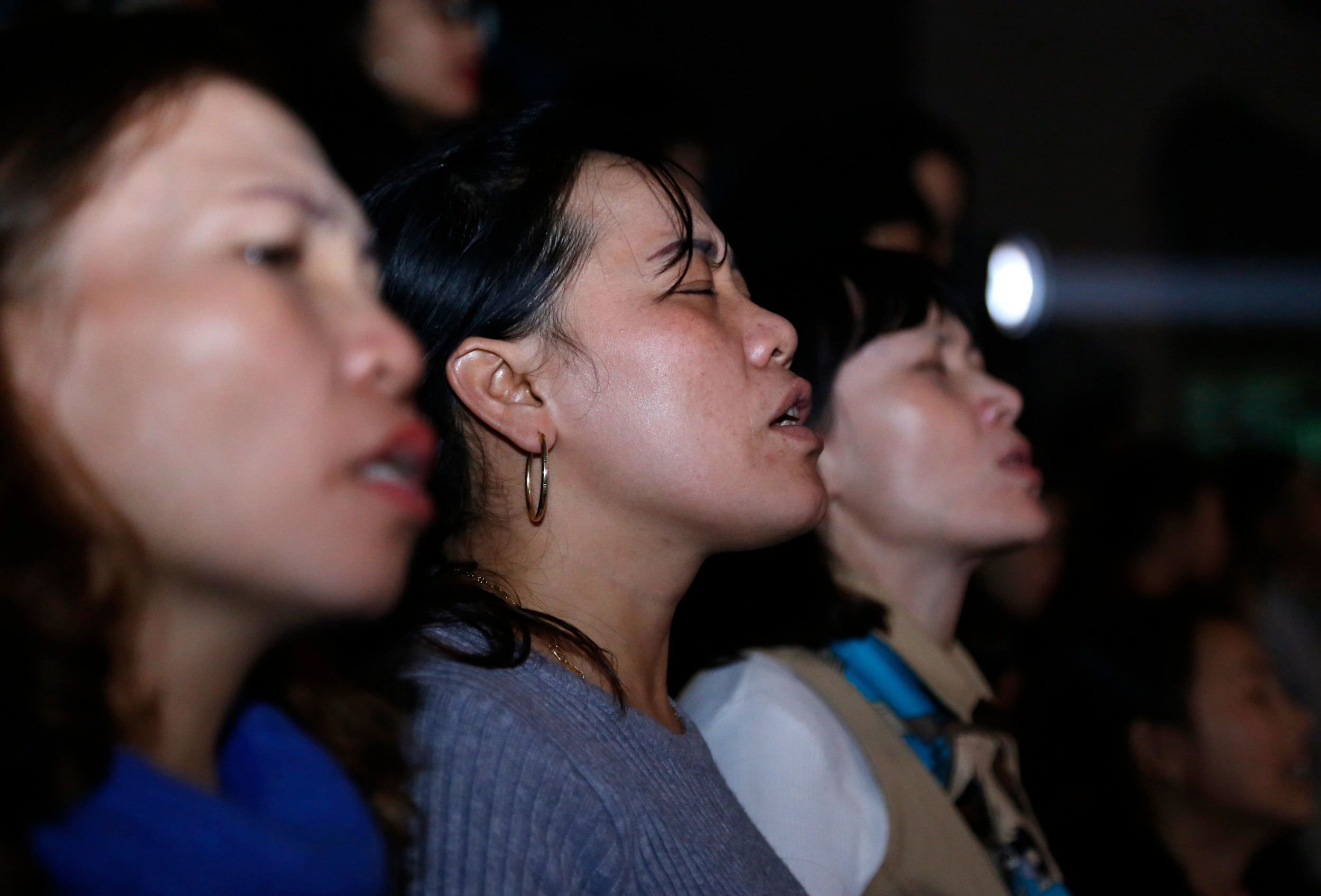 THE ASSOCIATED PRESSChristians pray during an event led by evangelist Franklin Graham in Hanoi, Vietnam, on Dec. 8.