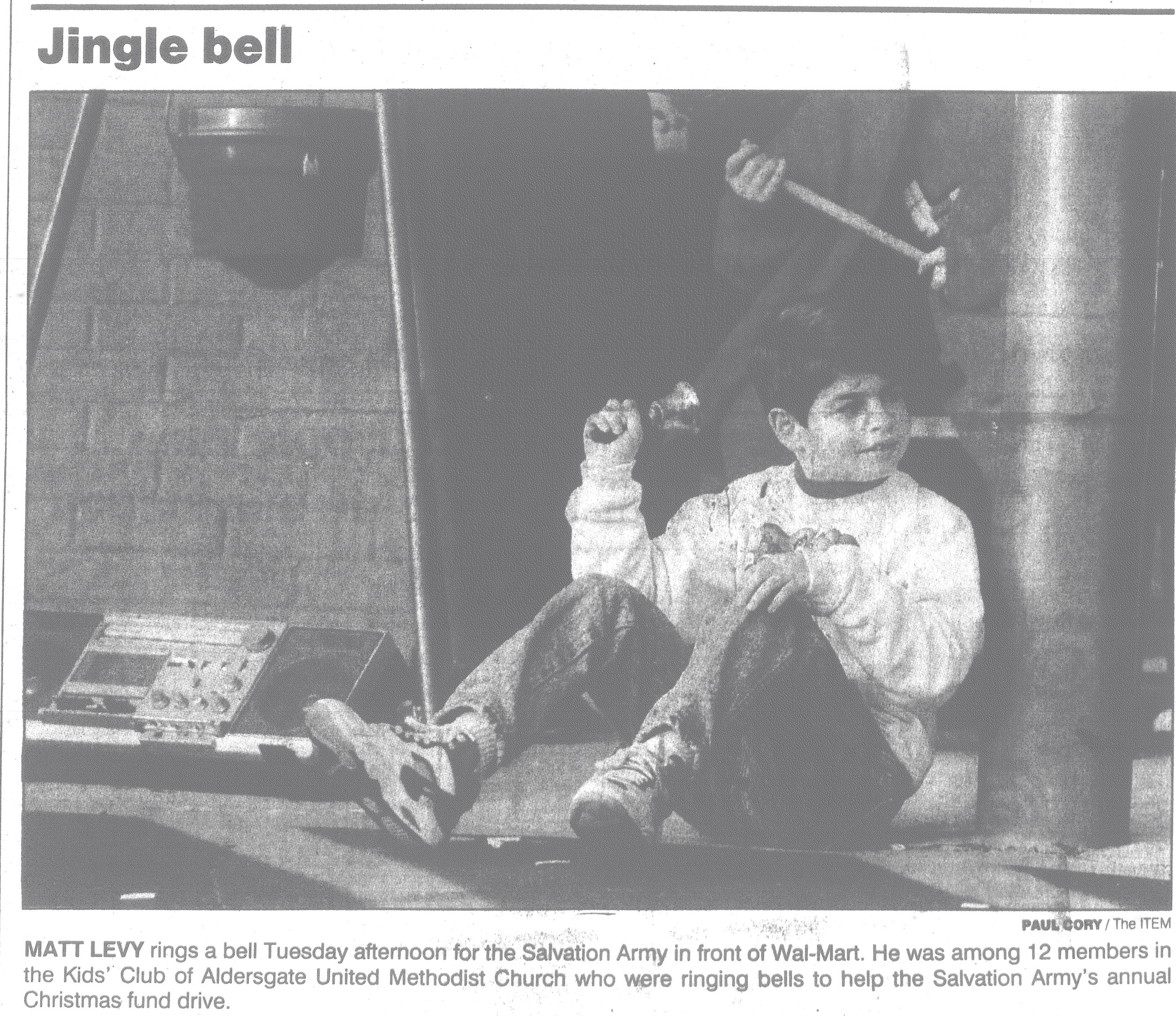 Matt Levy rings a bell Tuesday afternoon for the Salvation Army in front of Walmart in 1992. He was among 12 members of the Kids' Club of Aldersgate Methodist Church who were ringing bells to help the Salvation Army's annual Christmas fund drive.