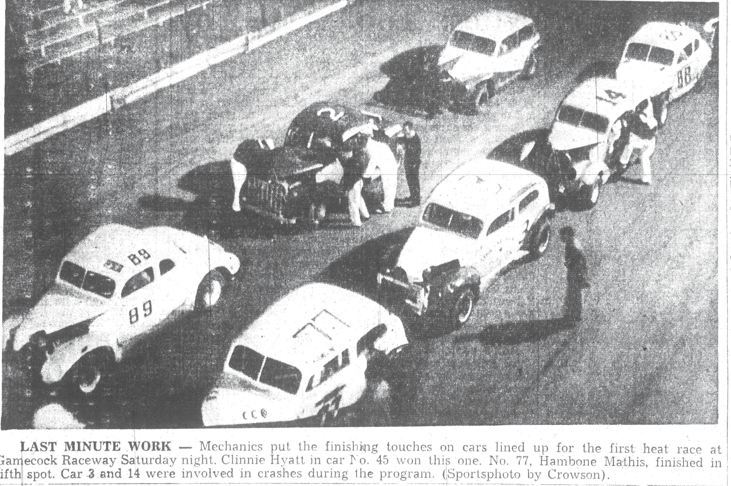 Mechanics put the finishing touches on cars lined up for the first heat race at Gamecock Raceway on a Saturday night in 1957.