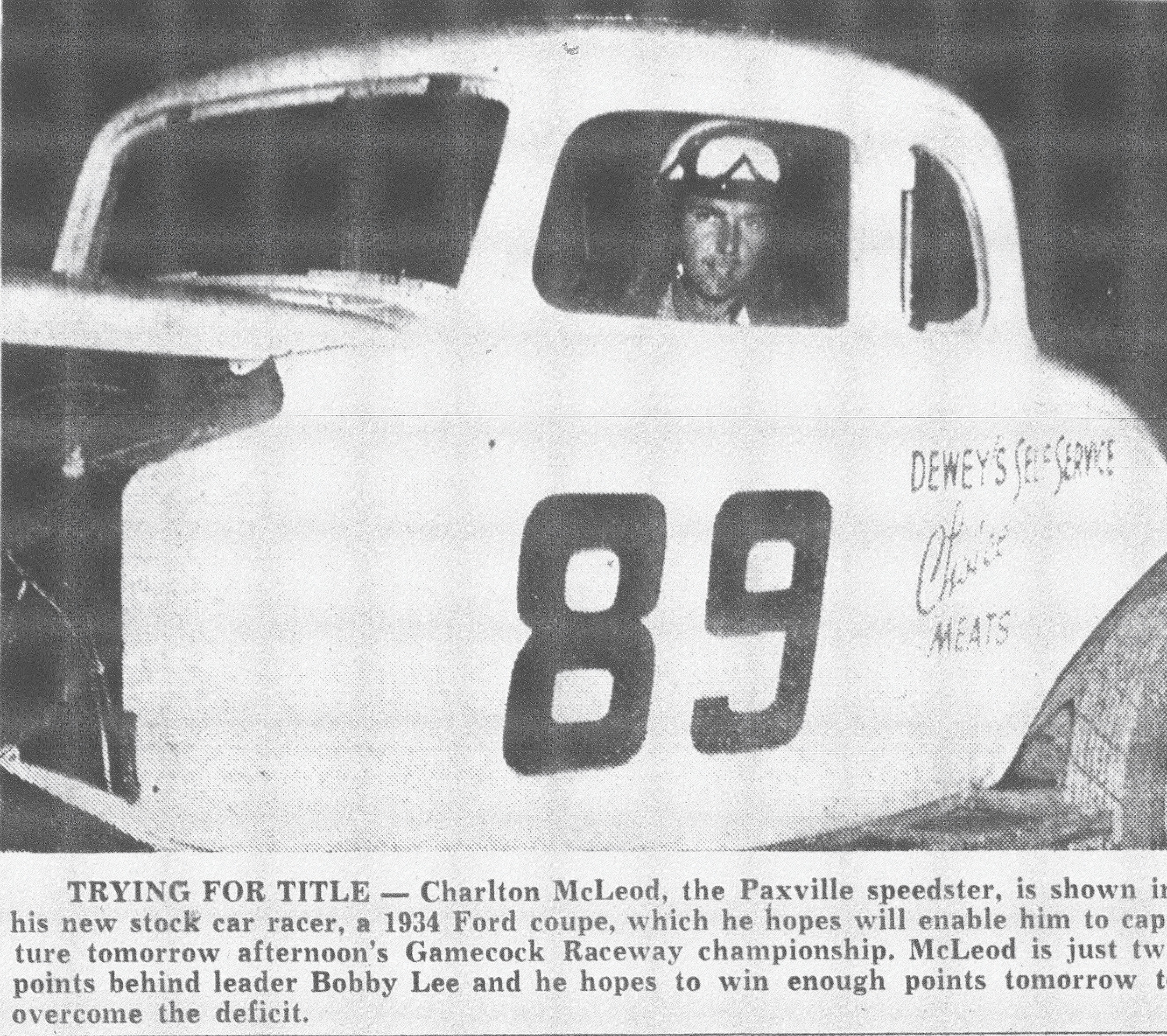 Charlton McLeod, the Paxville speedster, is seen in his new stock car racer, a 1934 Ford coupe, which he hoped would enable him to capture a Gamecock Raceway championship. McLeod was just two points behind leader Bobby Lee and hoped to win enough points to overcome the deficit.