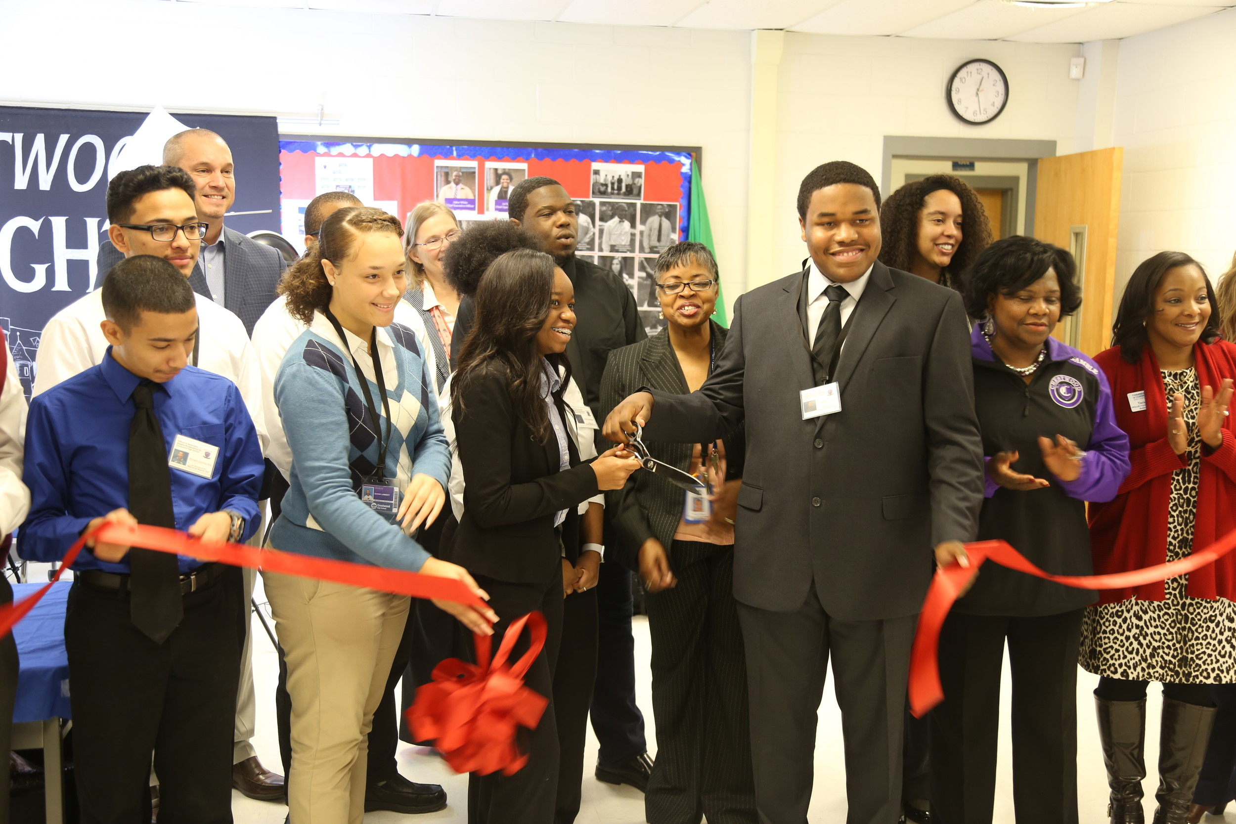 The student-staff of C. Wood TV's virtual enterprise class at Crestwood High School is all smiles Friday during a business ribbon-cutting ceremony put on for them by the Greater Sumter Chamber of Commerce.