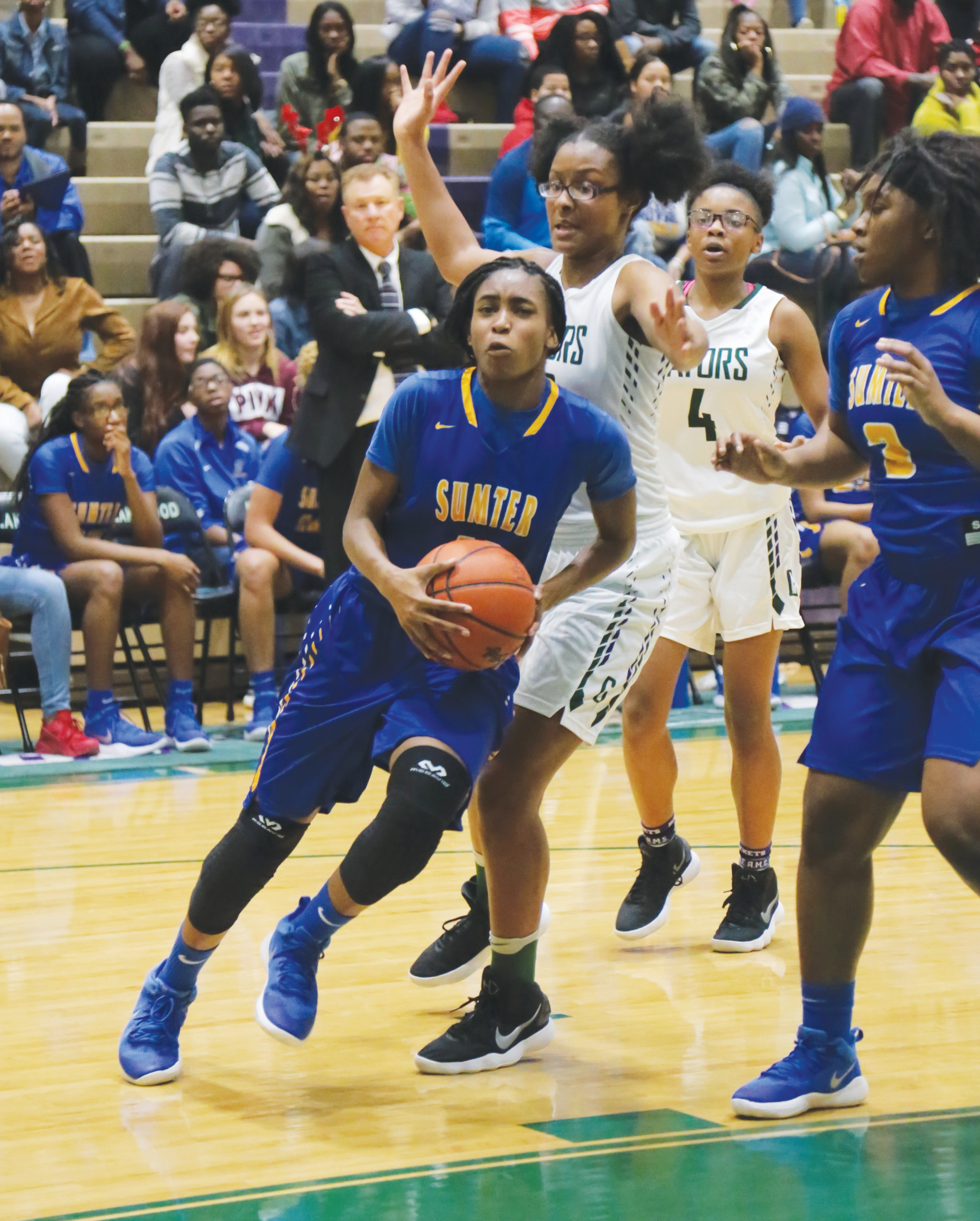 Sumter's Nina Edlow (11) drives to the basket during the second half of the Lady Gamecocks' 38-30 victory over Lakewood on Friday at The Swamp.