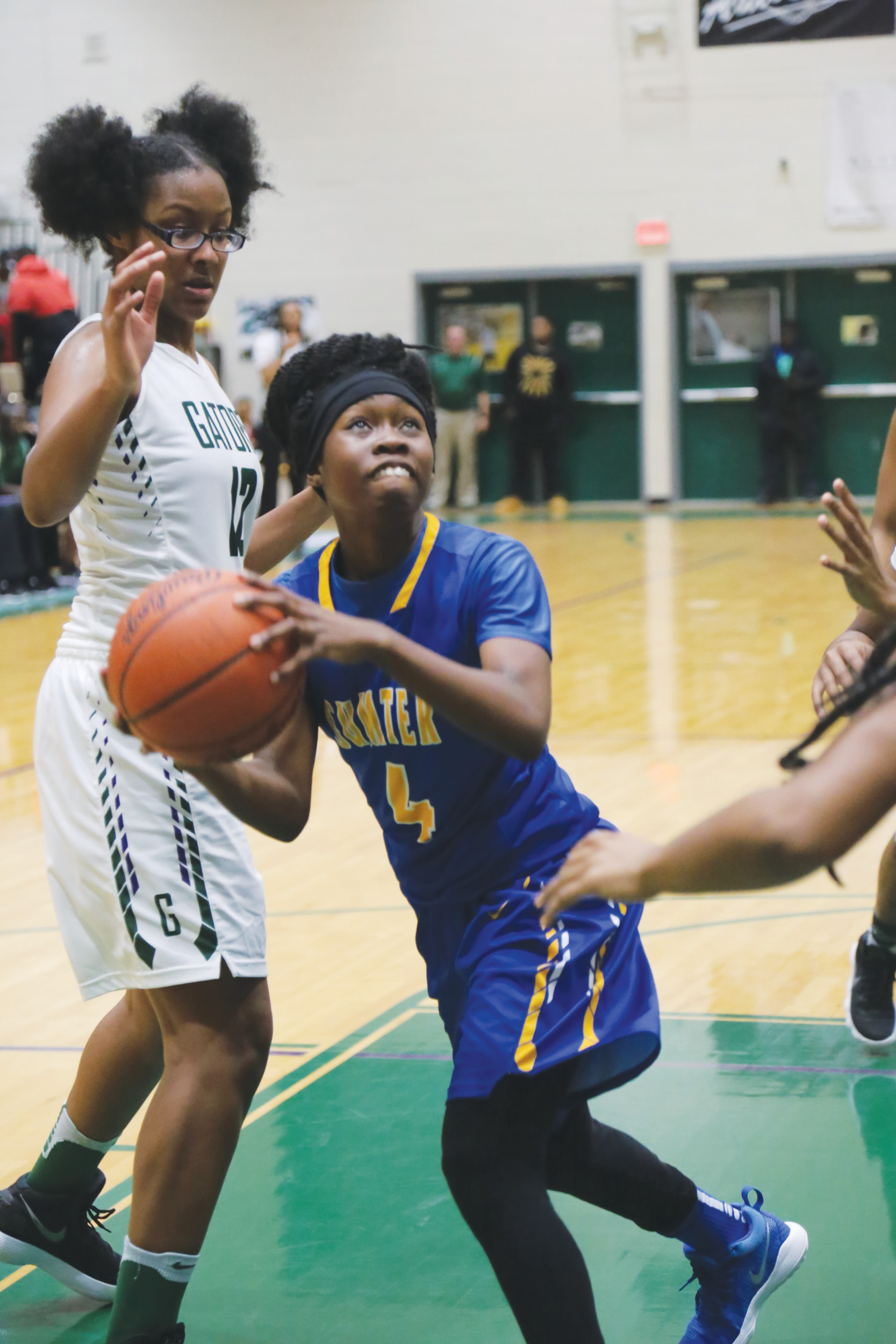 Sumter's Carnasia Wells (4)  looks for a shot against Lakewood's Rahteisha Burgess during the Lady Gamecocks' 38-30 victory on Friday at The Swamp.
