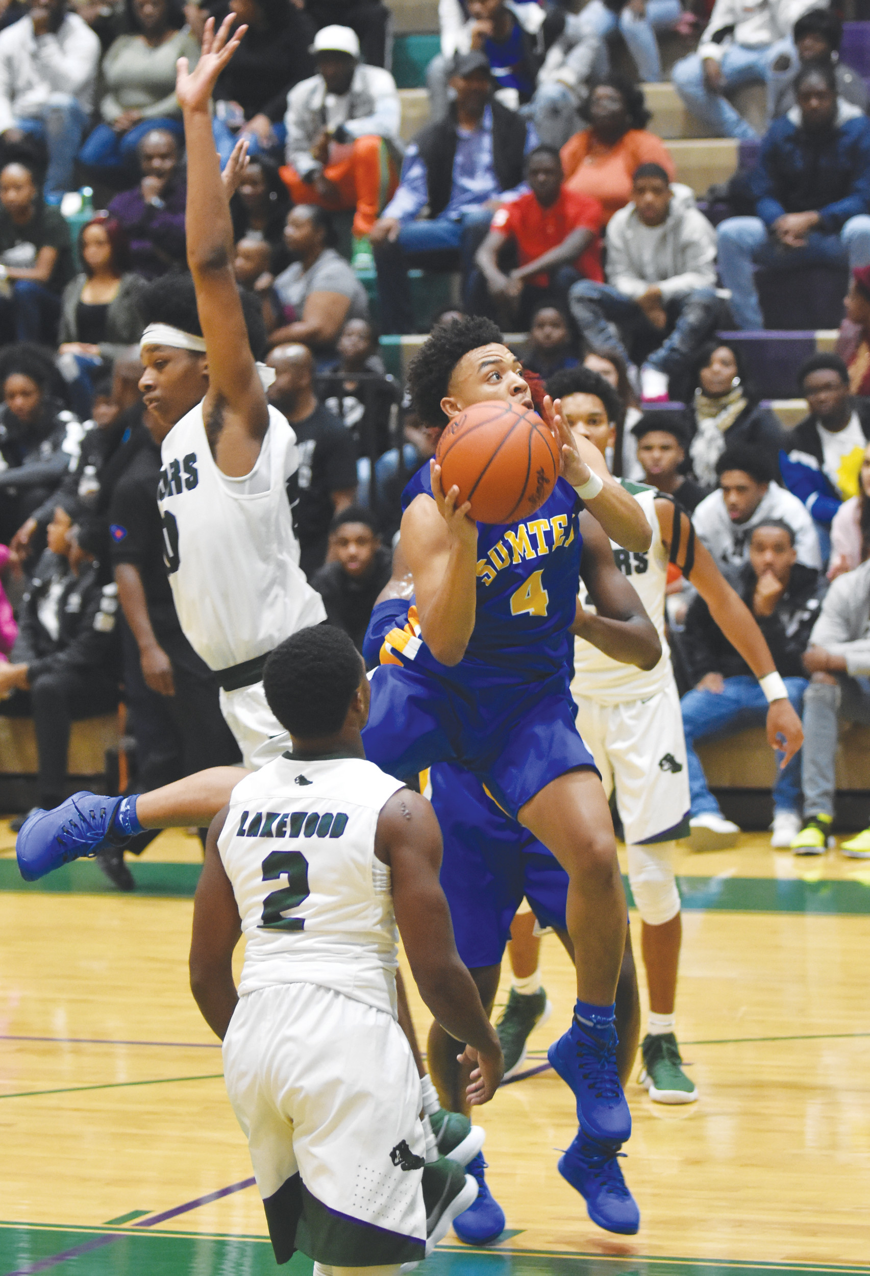Sumter's Cameron Singleton (4) puts up a shot in the fourth quarter of the Gamecocks' 70-37 victory over Lakewood on Friday at The Swamp.