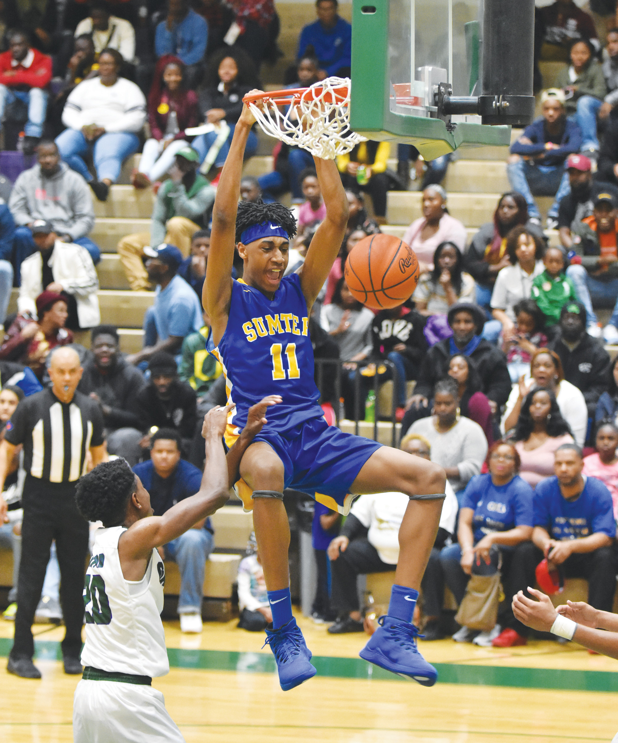 Sumter's Isaiah Moore (11) throws down a dunk for two of his game-leading 18 points in the Gamecocks' 70-37 victory over Lakewood on Friday at The Swamp.