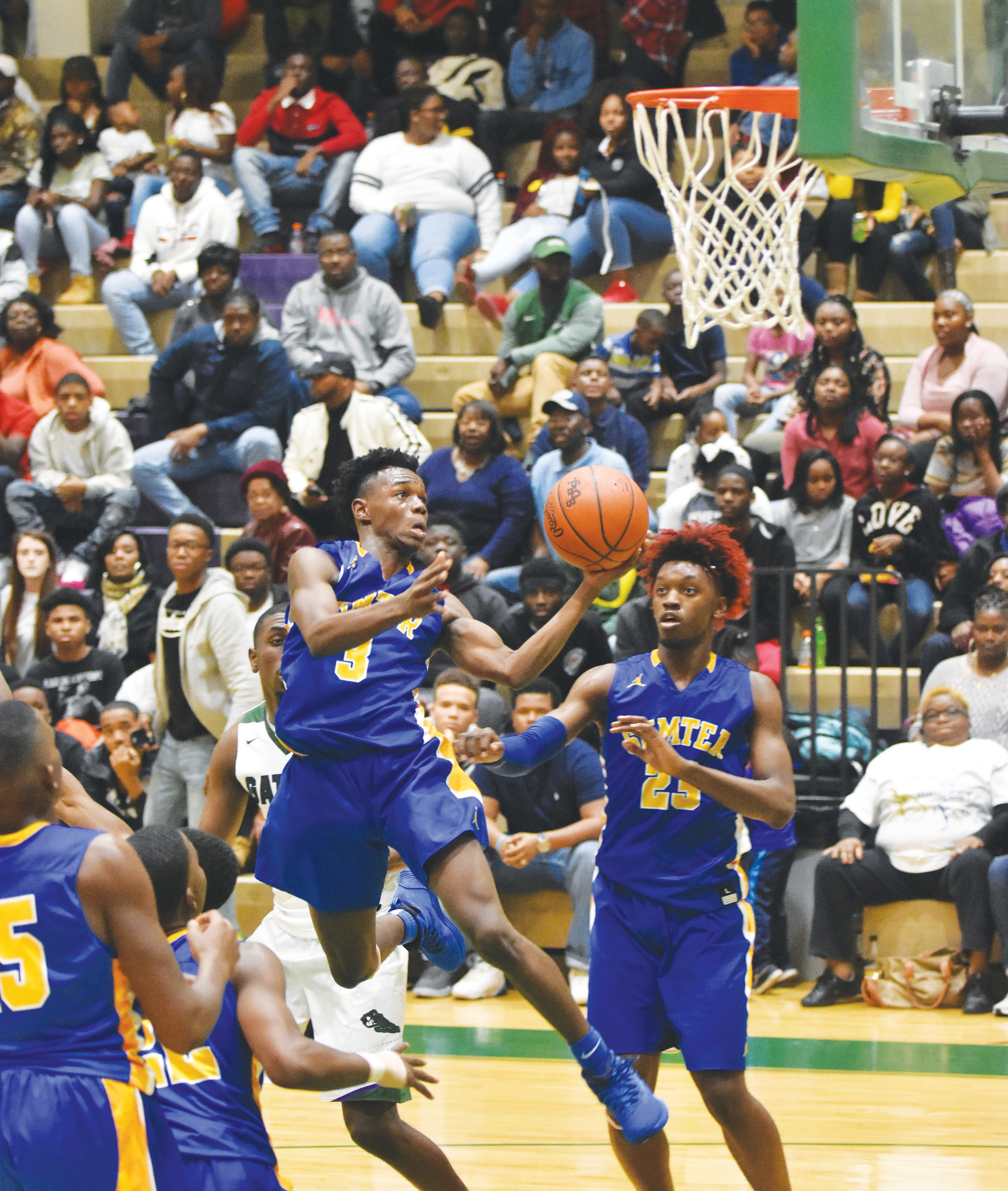 Sumter's Tyree Smalls (3) attempts a layup during the fourth quarter of the Gamecocks' 70-37 victory over Lakewood on Friday at The Swamp.