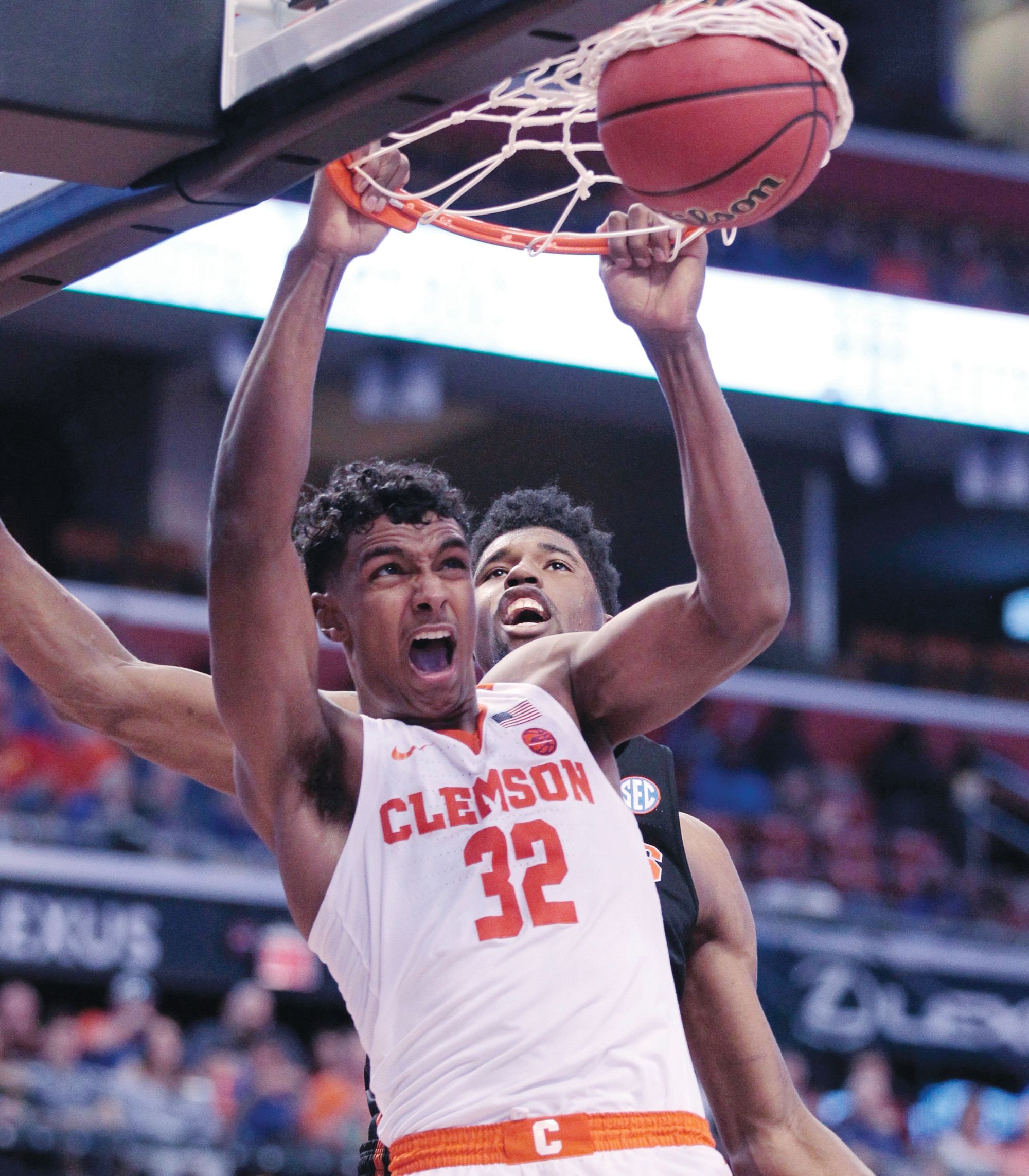 Clemson's Donte Grantham (32) slams the ball during the first half of the Tigers' 71-69 victory over the Gators in the Orange Bowl Classic on Saturday in Sunrise, Florida.