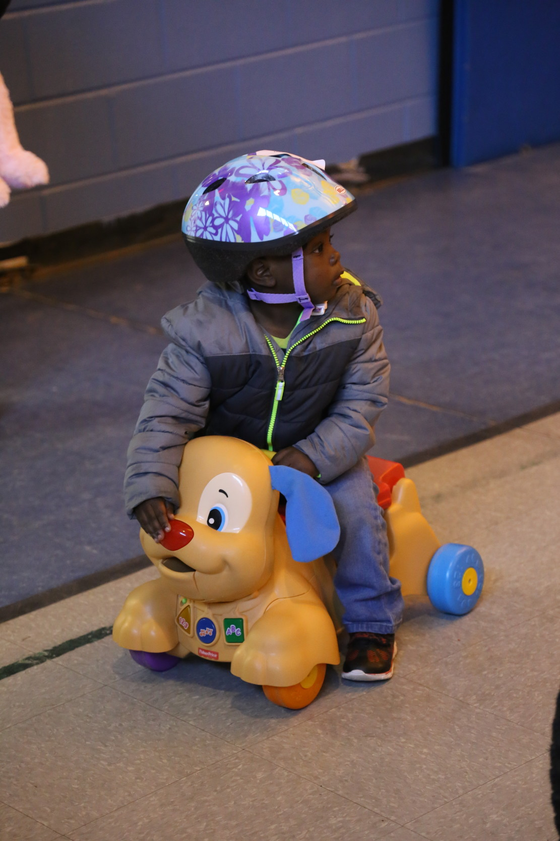 Riding toys for small children were also available during the giveaway.