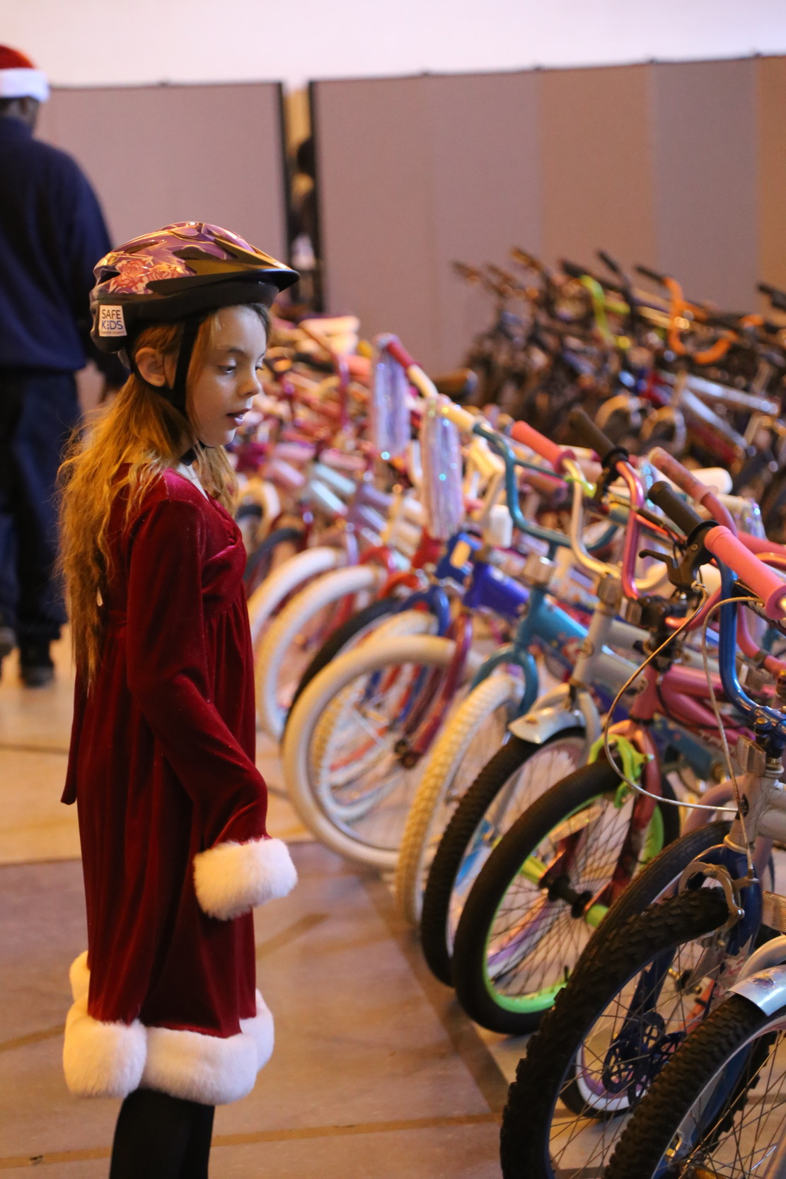 A child selected for Cycles for Christmas searches for the perfect bike.
