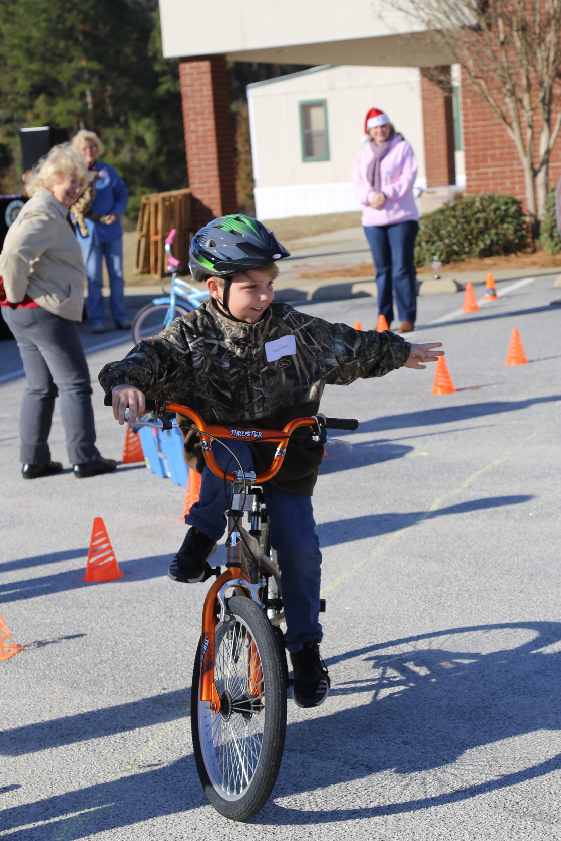 A child rides through the bike rodeo.