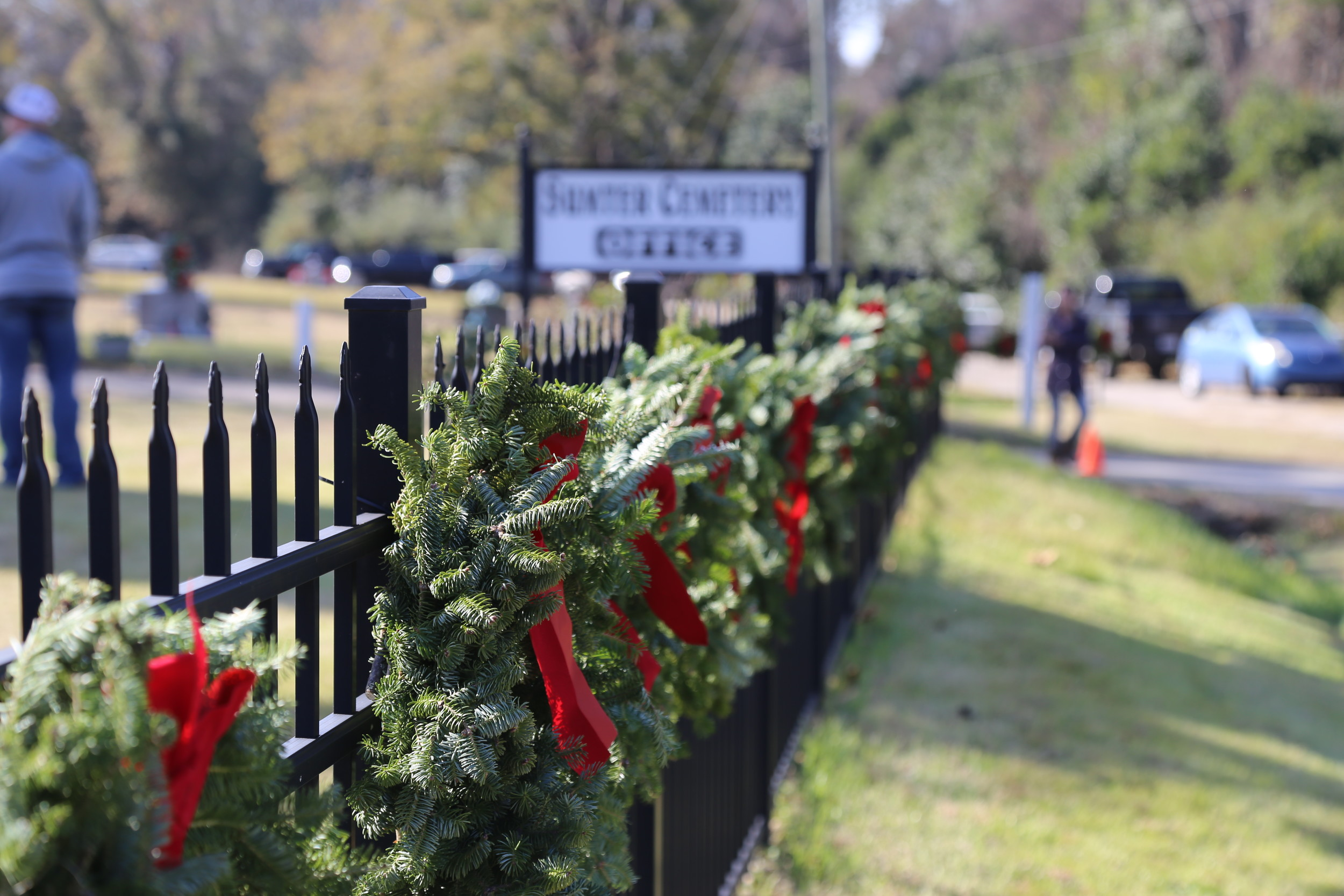 Wreaths hang along the fence at Sumter Cemetery on Saturday.